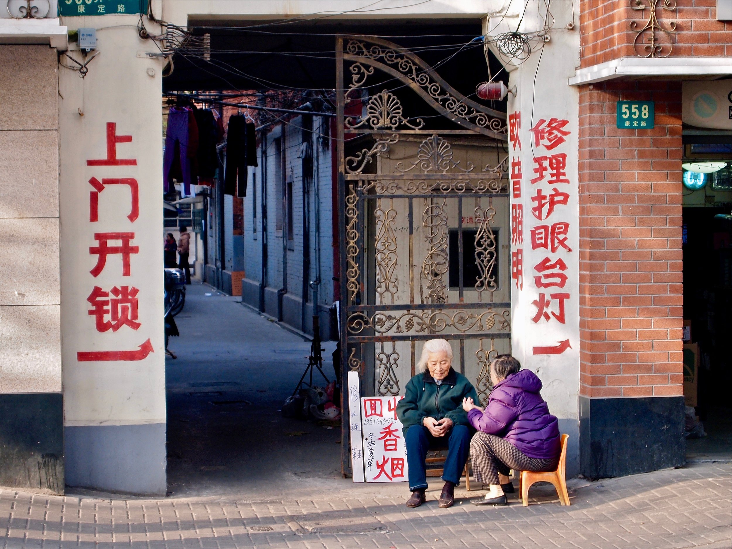 Women on a street in downtown Shanghai, China. (C) Remko Tanis