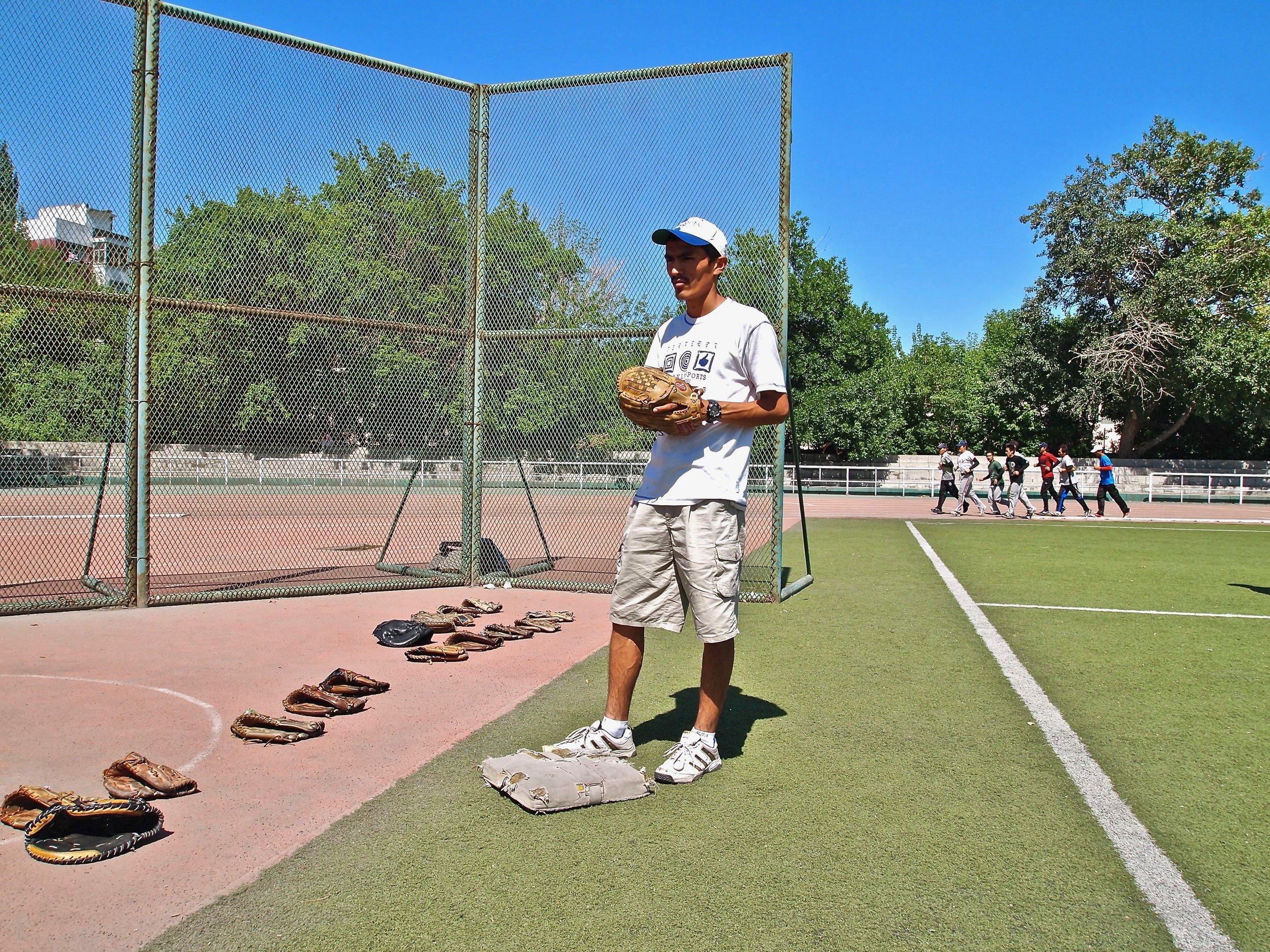 Baseball coach Parhat Ablat at a training of his Xinjiang Airplane Cats team at Urumqi University in Xinjiang, China. (C) Remko Tanis