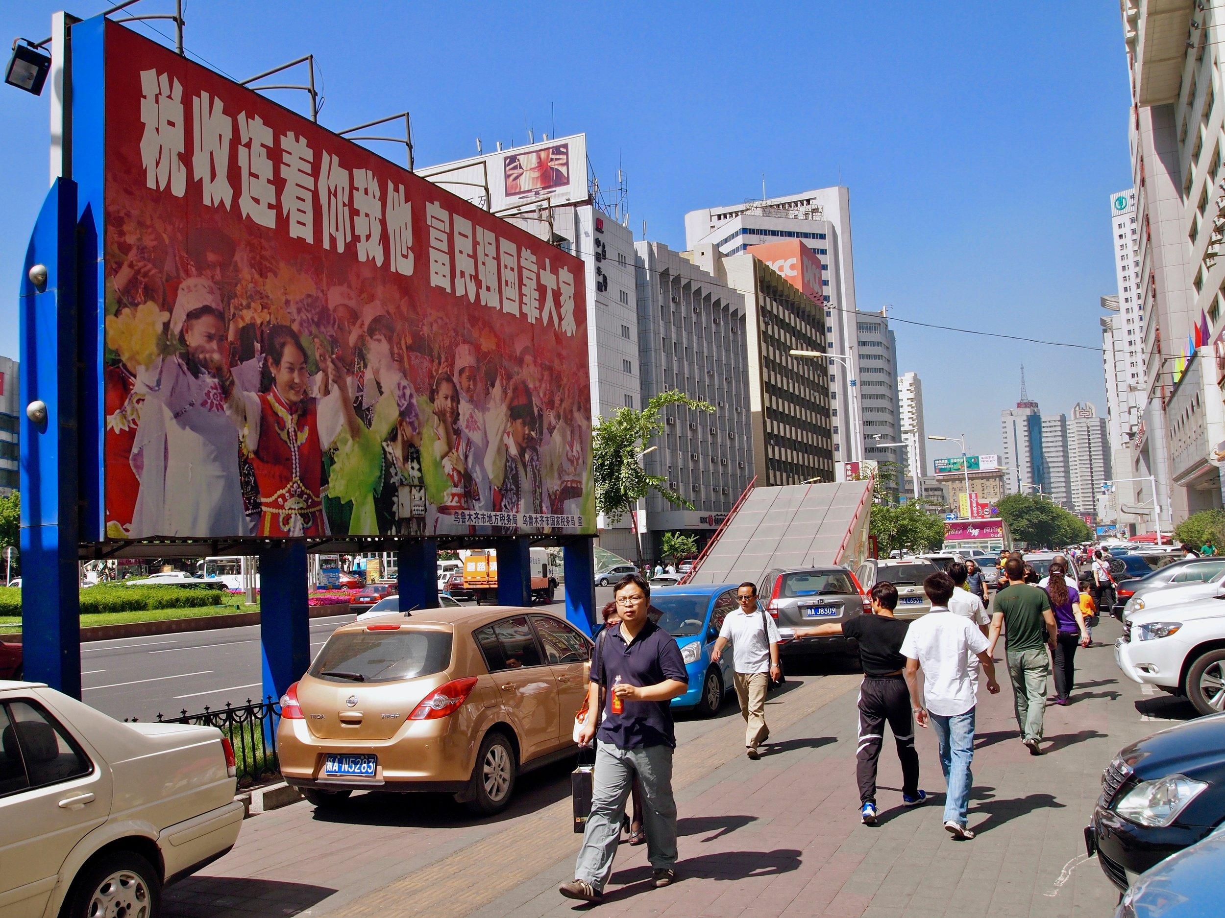A billboard featuring Uyghur women of Xinjiang, in a Han Chinese area of Urumqi, Xinjiang, China. (C) Remko Tanis