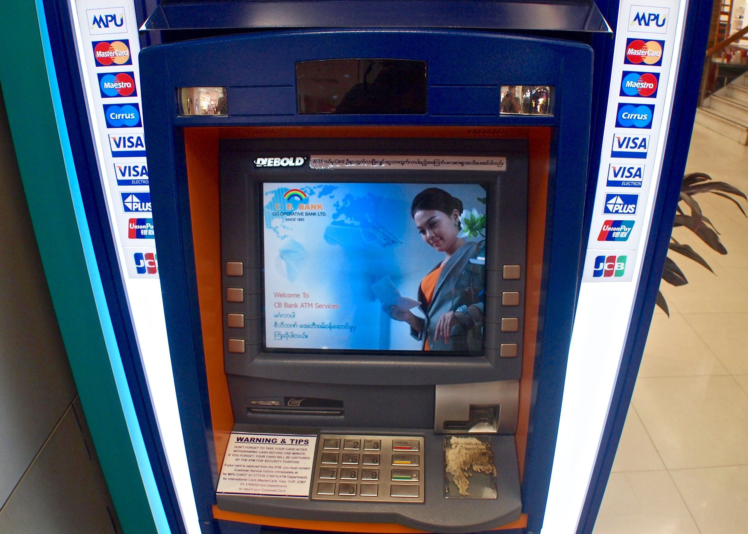 A brand new ATM in Junction Center shopping mall, Yangon, Myanmar. (C) Remko Tanis