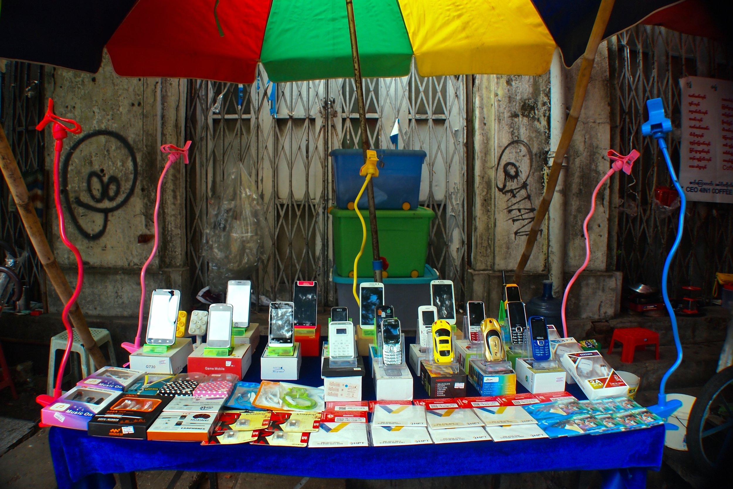 Street stall selling mobile phones and SIM-cards in Yangon, Myanmar. (C) Remko Tanis