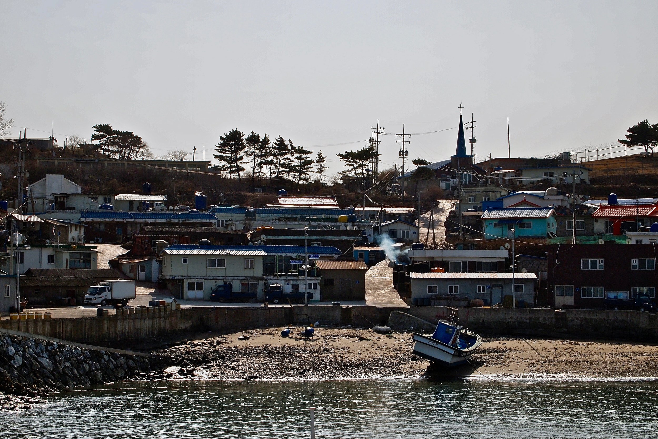 South Korea evacuated the 1400 residents of Yeonpyeong Island after it was hit by shelling from North Korea, killing four people. (C) Remko Tanis