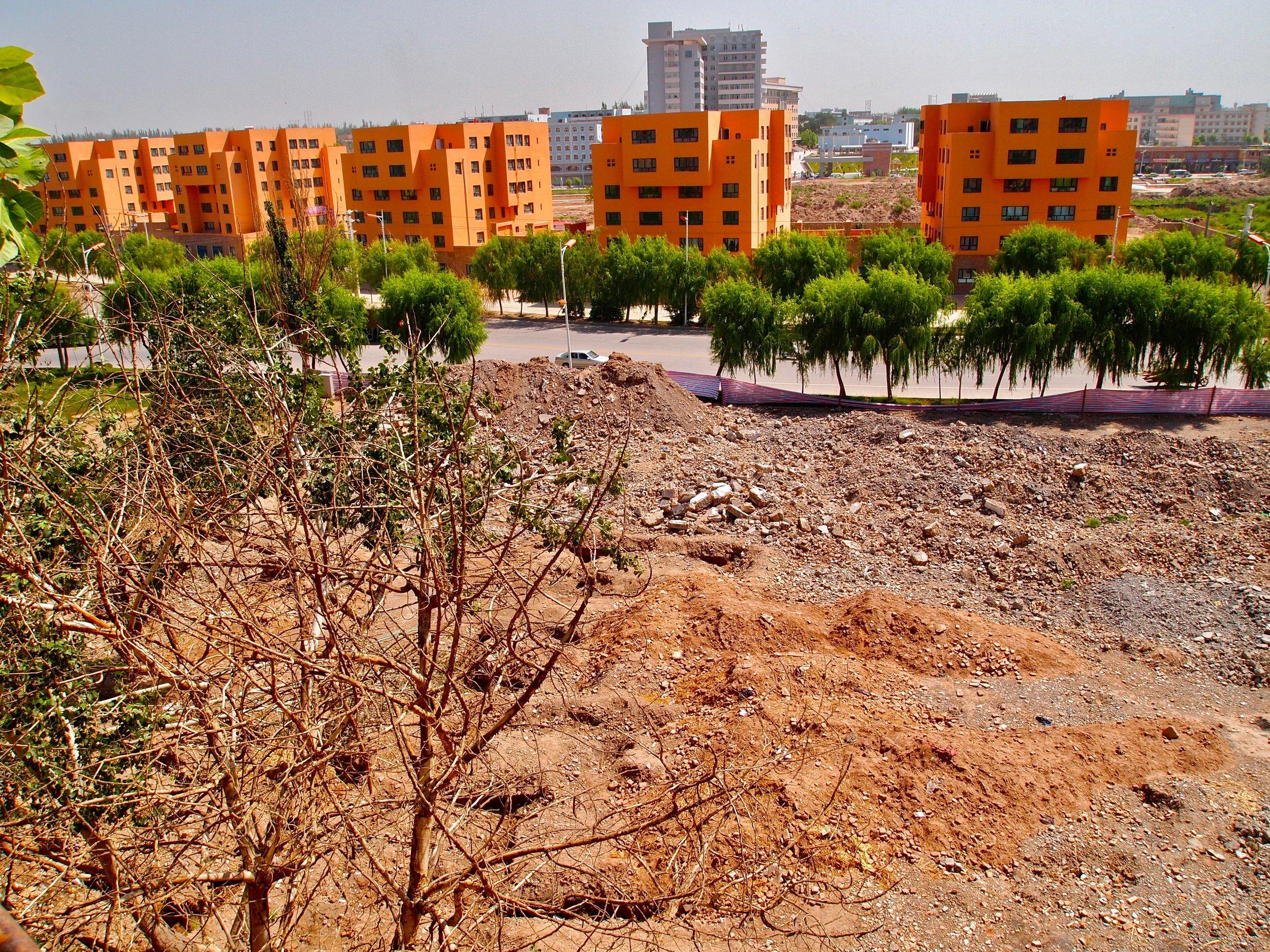 New apartment blocks bordering a demolished part of old Kashgar, Xinjiang, China. (C) Remko Tanis
