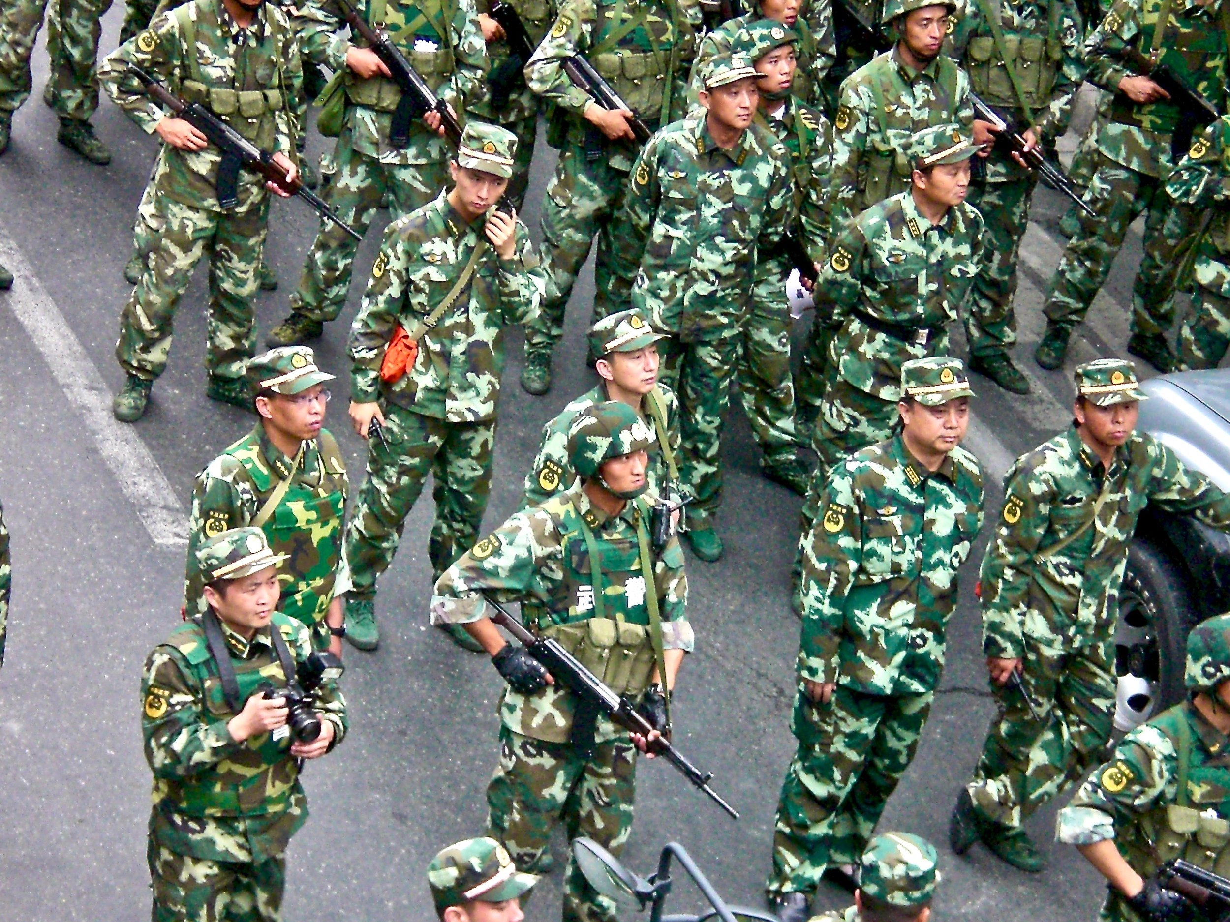 Chinese soldiers in the streets of Urumqi, Xinjiang, after deadly ethnic riots in 2009. (C) Remko Tanis