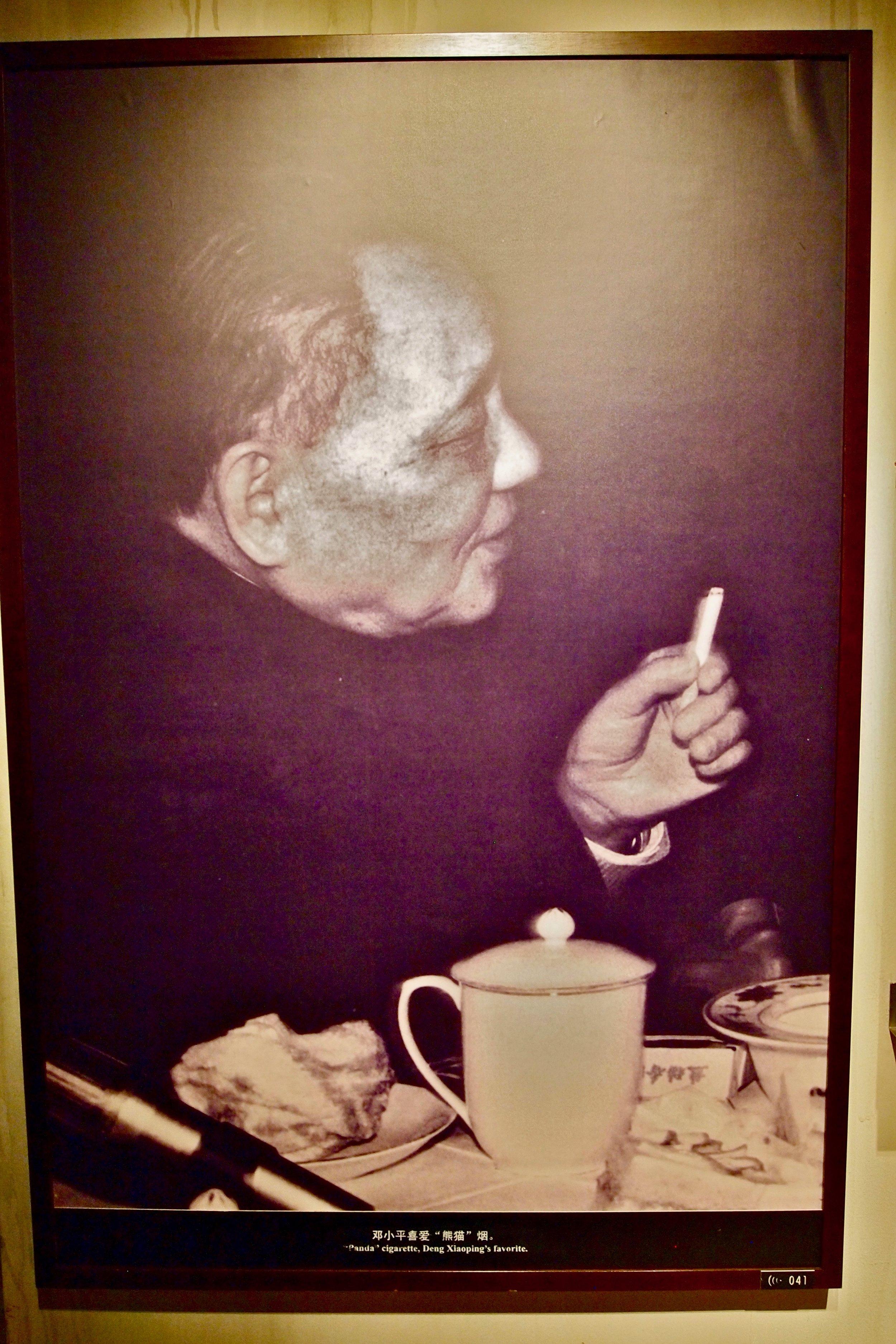Deng Xiaoping smoking his favorite Panda brand cigarette.