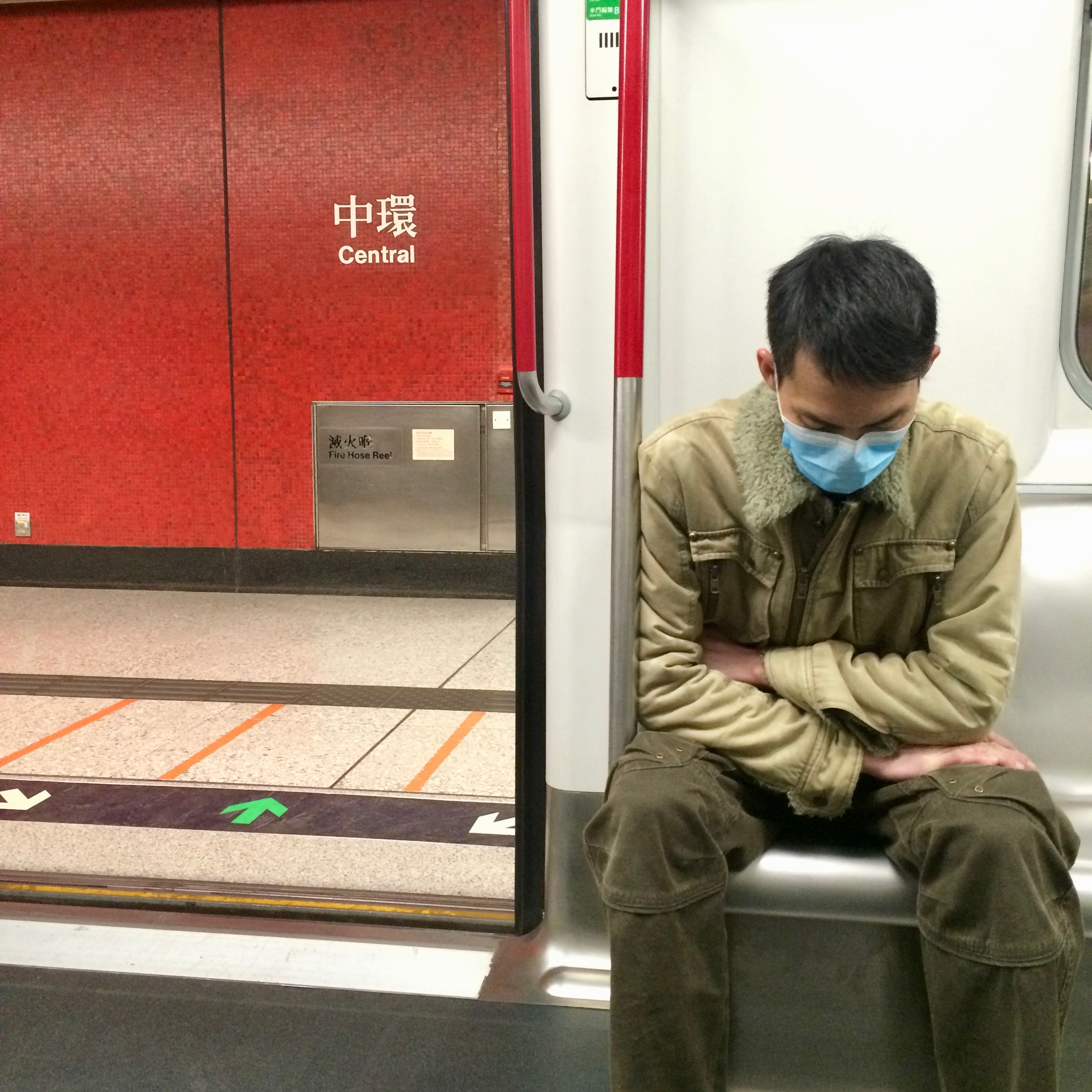 A passenger on the Tsuen Wan Line of the Hong Kong metro. Photo: (C) Remko Tanis