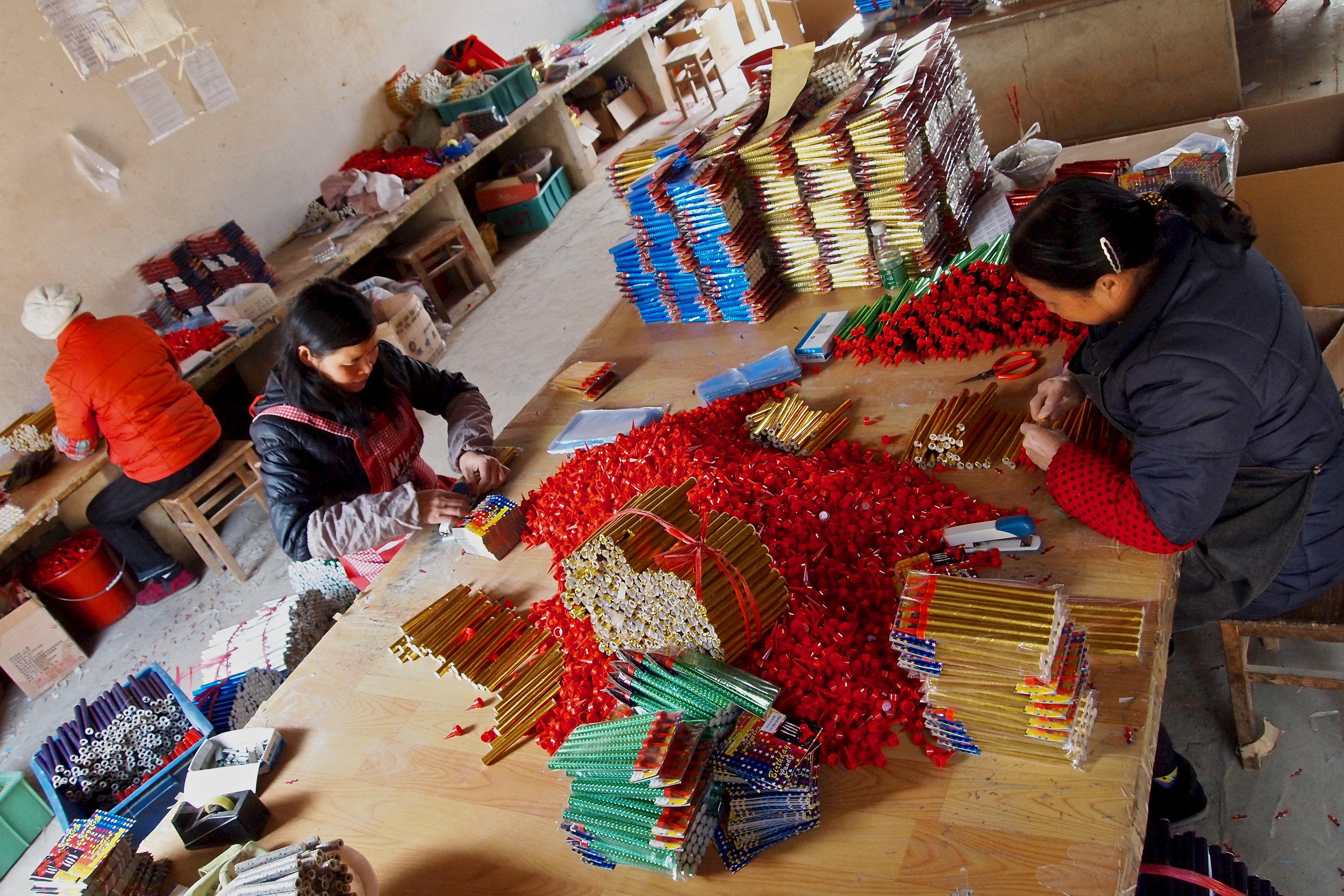 Employees labeling fireworks at Dream Fireworks in Liuyang, China. Photo: (C) Remko Tanis