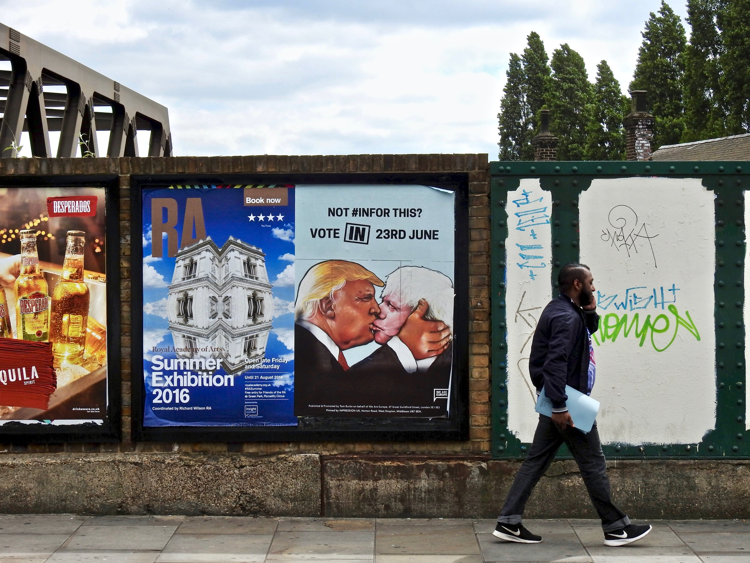 A 'Remain' campaign poster featuring a kissing Donald Trump and Boris Johnson in London, 2016. Photo: (C) Remko Tanis