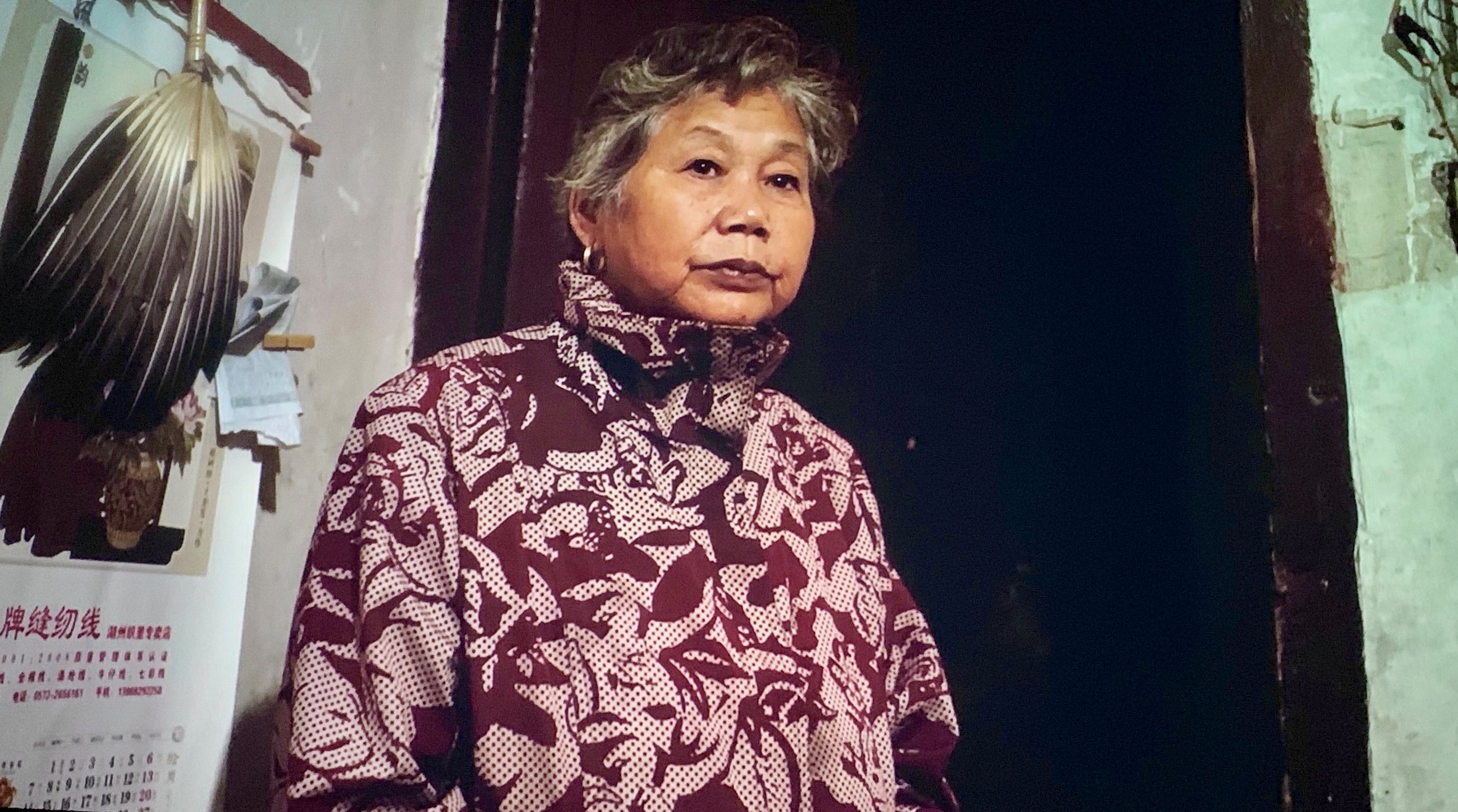 Mrs. Fang before her illness bound her to bed. Still from Wang Bing film  Fang Xiu Ying.