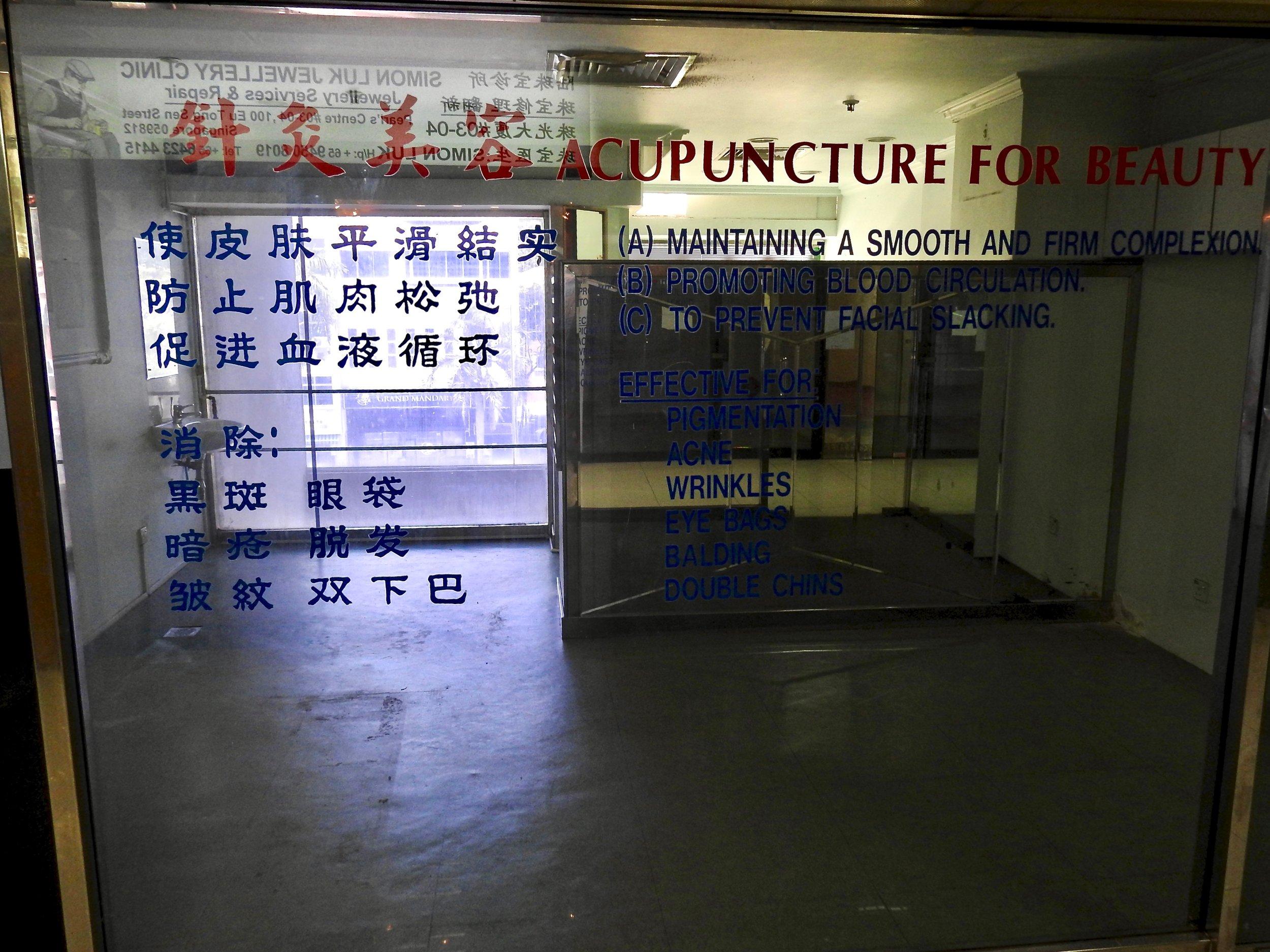 Closed acupuncture  shop in Pearls Centre, Singapore. Photo: (C) Remko Tanis
