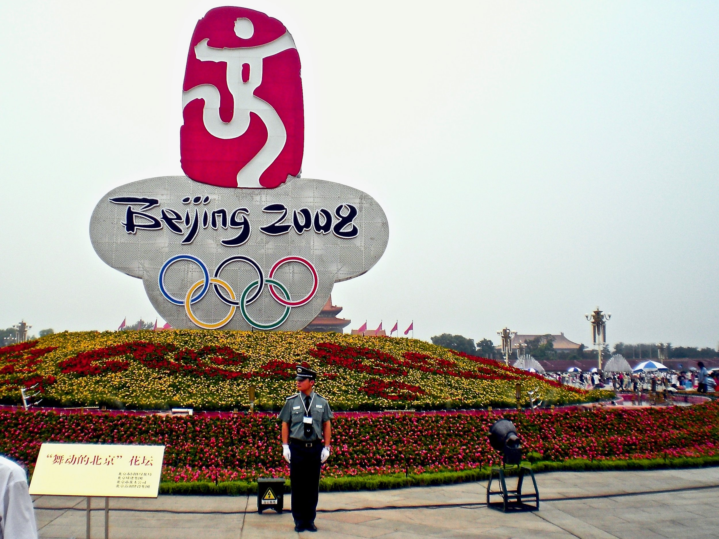 A guard in front of the logo for the 2008 Beijing Olympic Games on Tiananmen Square, Beijing, China. Photo: (C) Remko Tanis