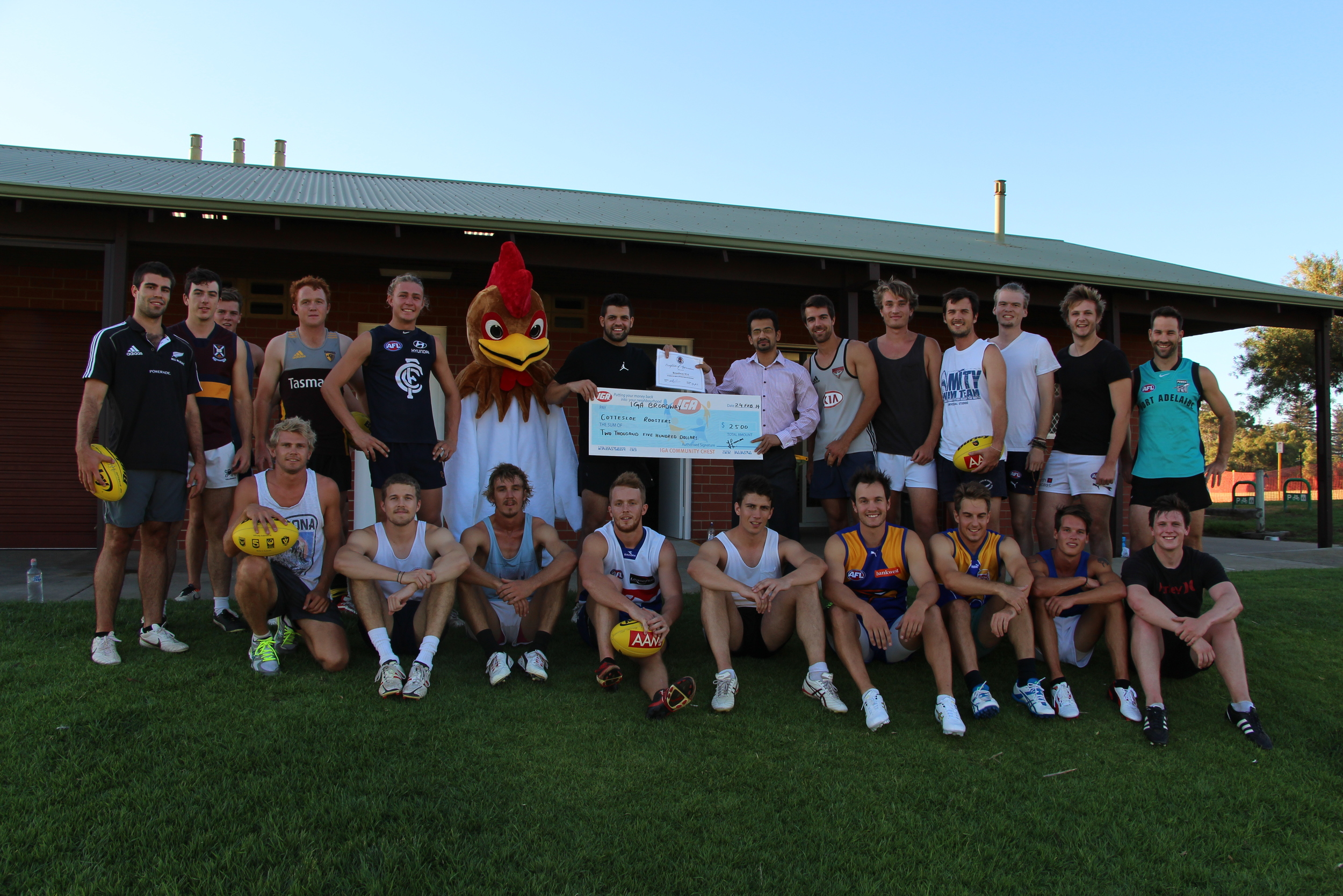 Pictured: Hassan from IGA Broadway Nedlands (sponsor) with players and mascot
