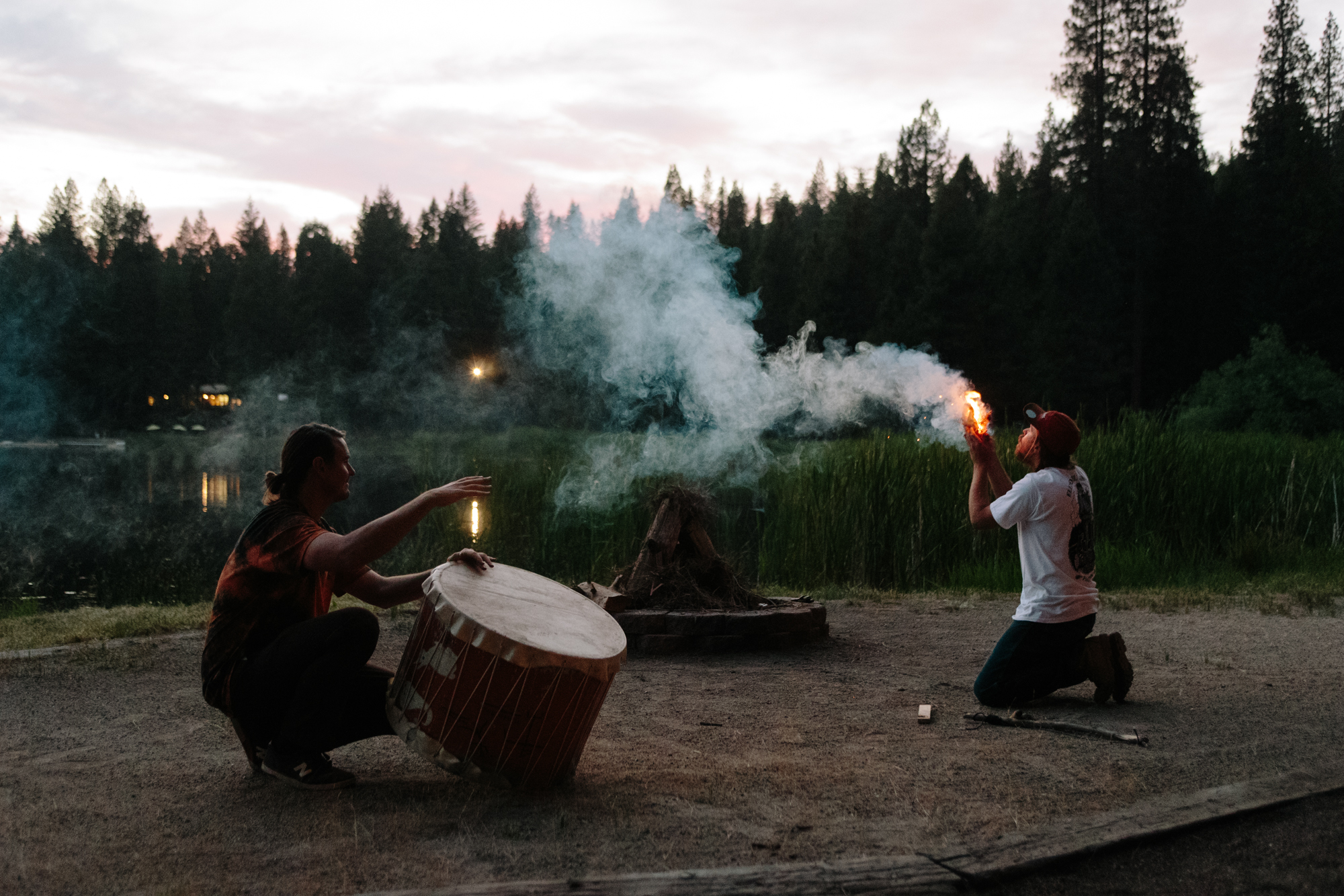 Elemental Awareness Instructors Todd Larsen and Matt Luciani Start Camp fire by demonstrating how to make fire with a bow drill.jpg
