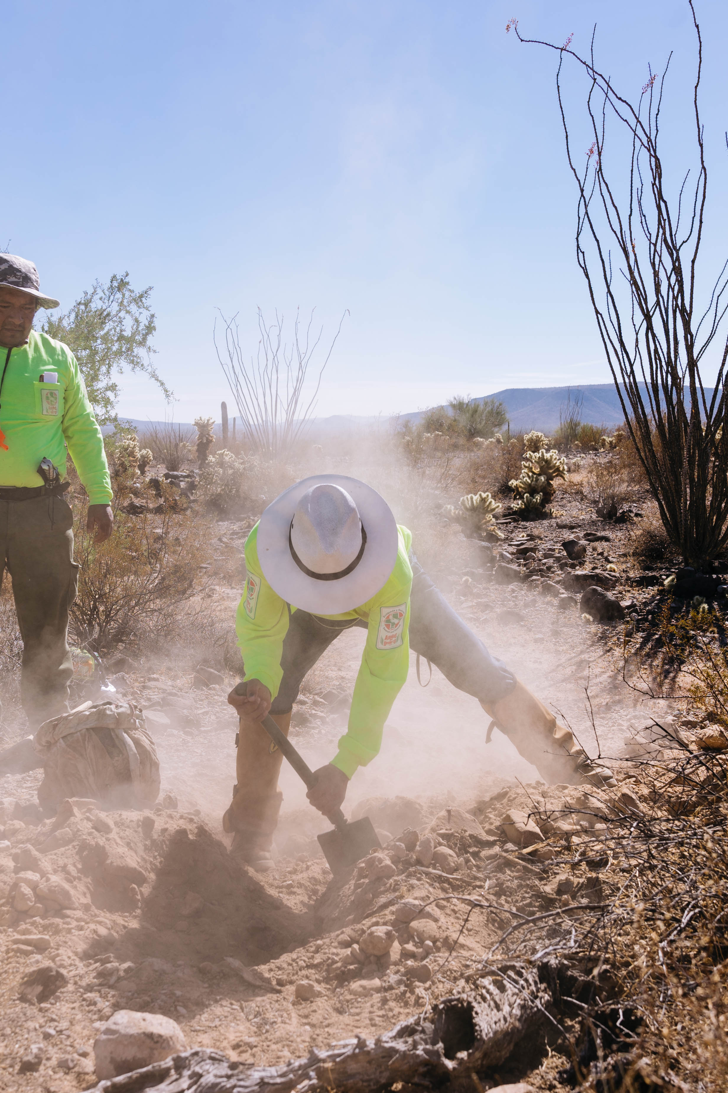 Members of Aguilas Del Desierto dig in the Sonoran Desert where they suspect the body of a migrant has been buried in a shallow grave. Most migrants who die crossing this treacherous desert have been left behind by their guides and quickly succumb to dehydration.