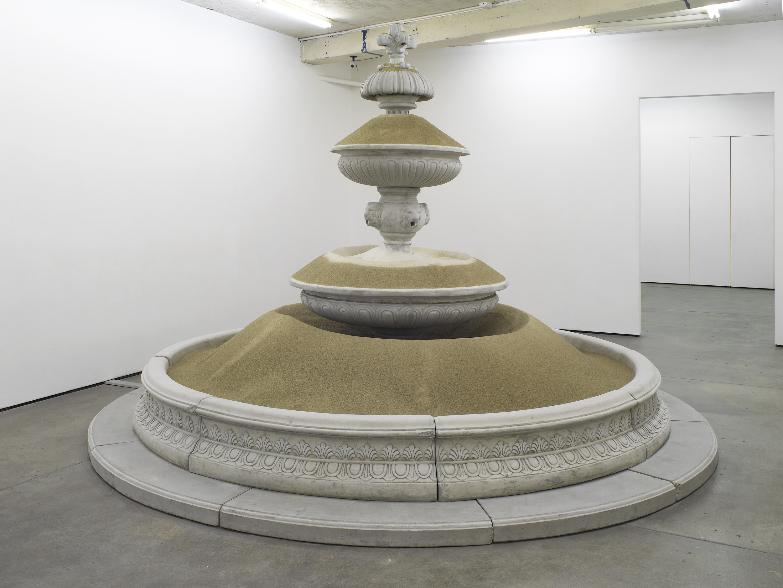 Sandfountain   2012   Prefabricated concrete fountain, sand   250 x 400 x 400 cm / 98.4 x 157.4 x 157.4 in
