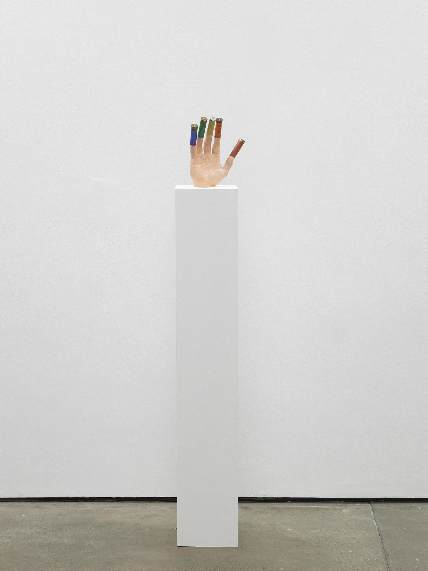 Fortune Teller   2011   Plaster, shotgun shells, paint   Sculpture: 23 x 28 x 10 cm / 9 x 11 x 3.9 in,  Plinth:120 x 20 x 37 / 47.2 x 7.8 x 14.5 in
