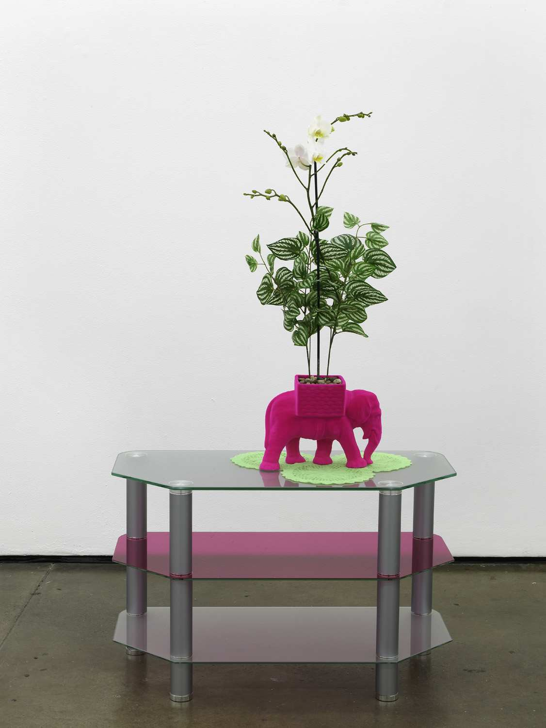 Matthew Darbyshire Untitled Homeware No. 14 2011 fuchsia flocked elephant planter, lime flocked doilies, artificial orchid, coloured glass gels,  glass and steel support: 140 x 80 x 40 cm