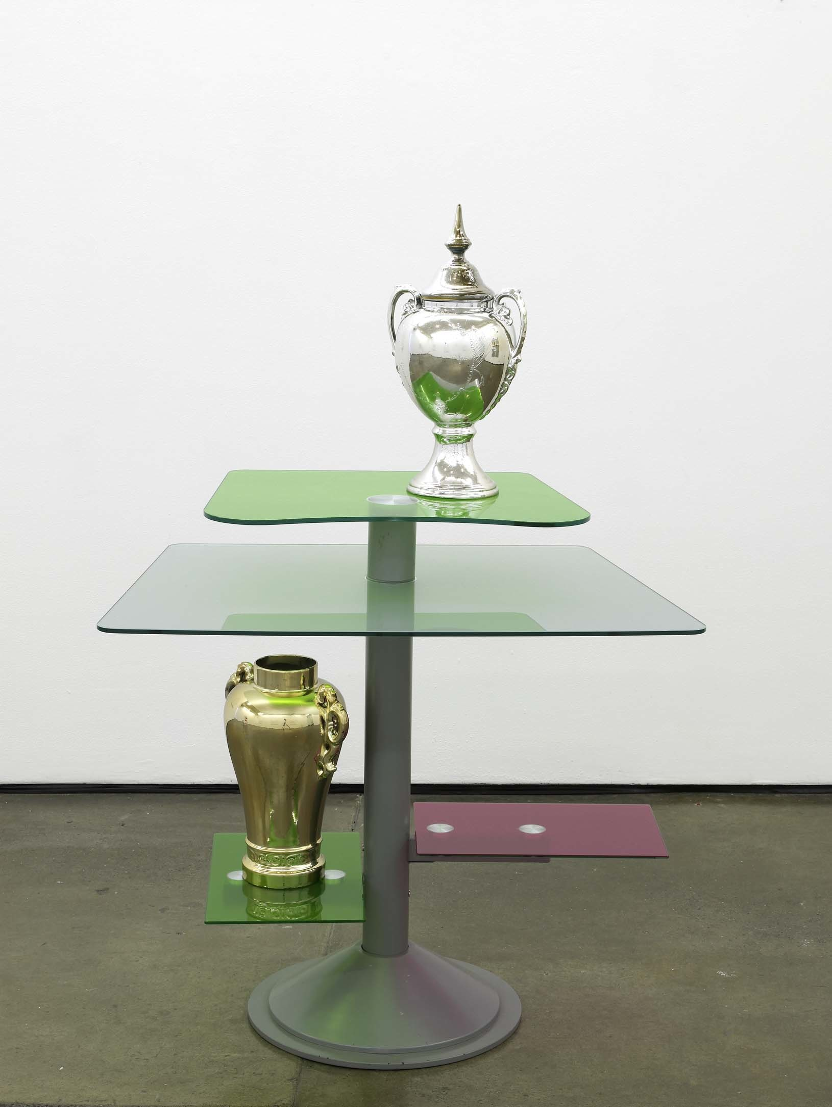 Matthew Darbyshire Untitled Homeware No. 15 2011 chromed gold and silver urns, coloured glass gels, glass and steel support 130 x 90 x 60 cm