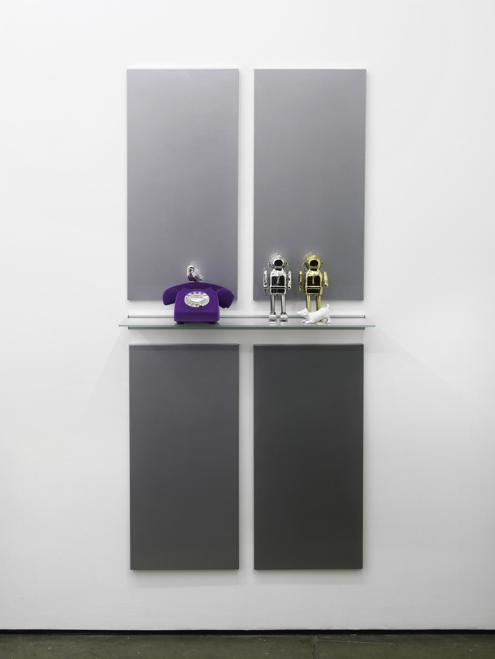 Matthew Darbyshire Untitled Homeware No. 12 2011 Chromed silver and gold toy robots, purple flocked telephone, painted white Beswick dog ornament,  glass and steel support: 172 x 80 x 16.5 cm