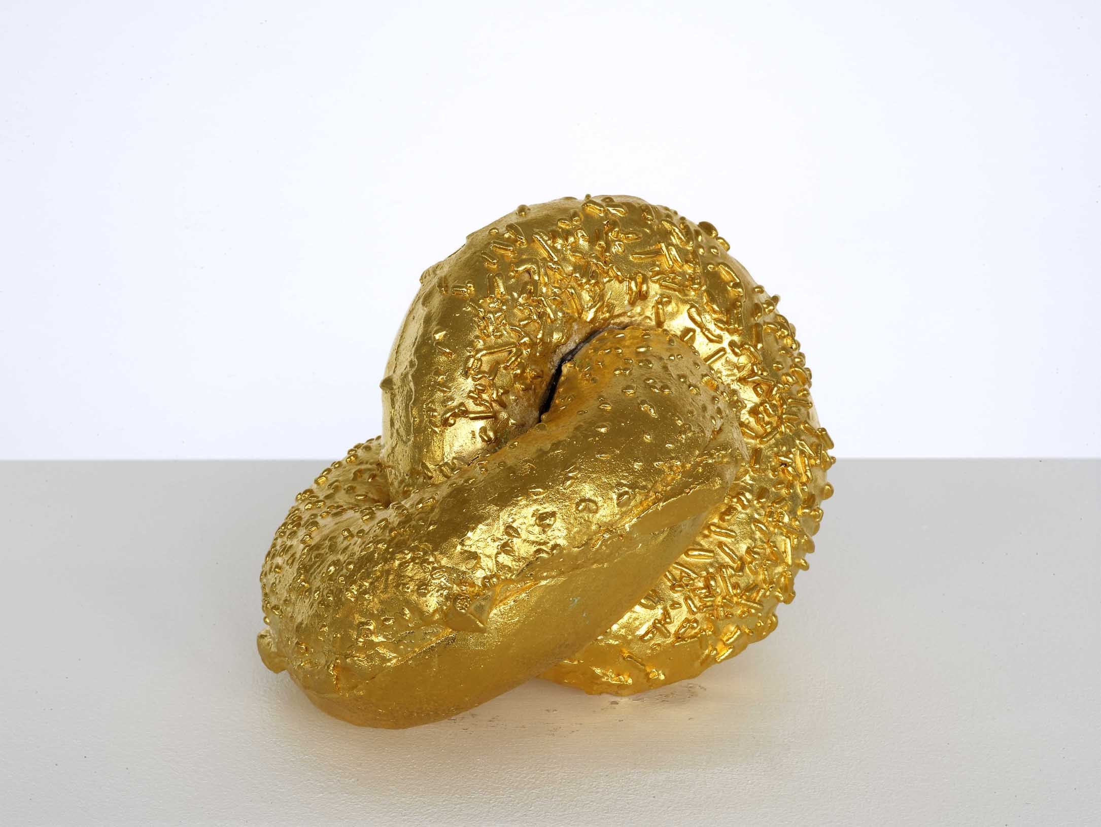 Untitled (Donut, Bagel, Hopf Link) 2010 Gold plated bronze 17.8 x 10.2 x 10.2 cm / 7 x 4 x 4 in