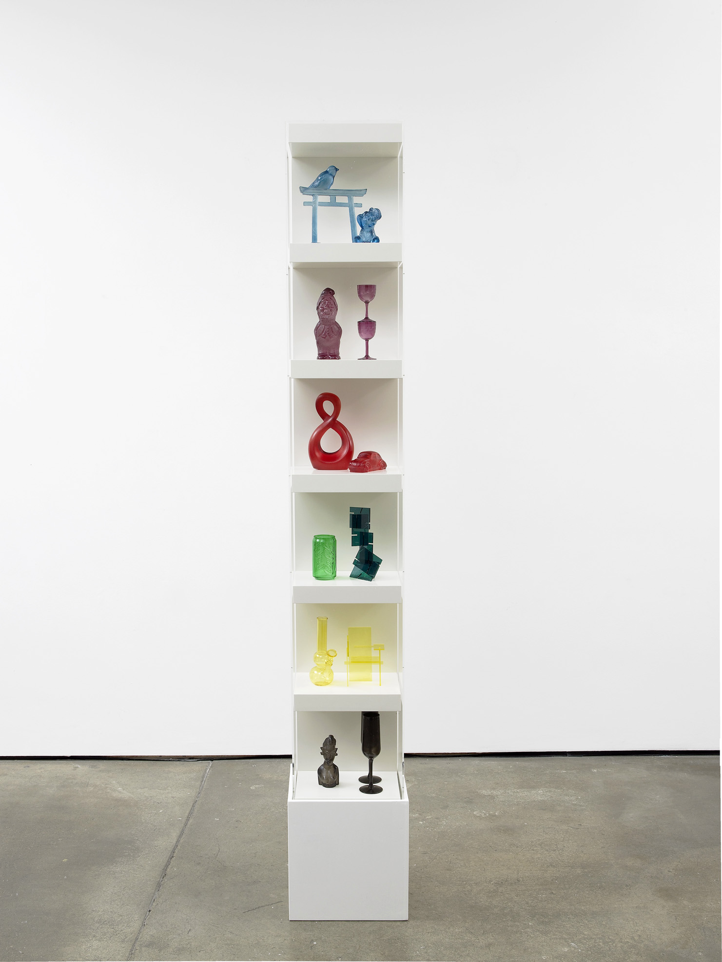 Matthew Darbyshire Untitled: Accessorised Column No. 5 2012 Plastic, glass, and resin components, shelving units, and perspex case 215 x 30 x 30 cm