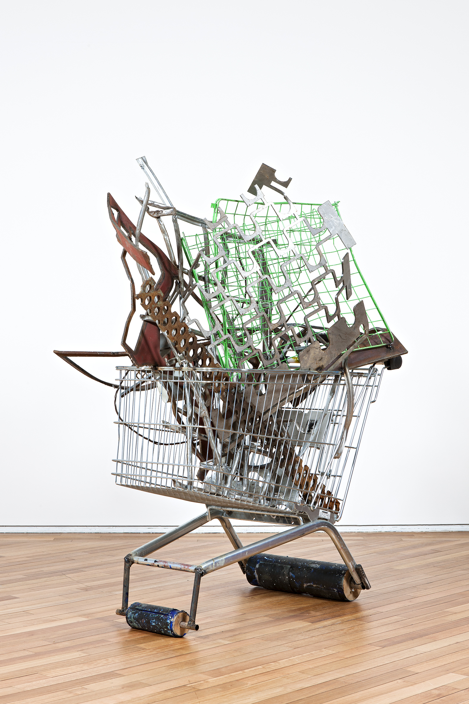 Wagon (Two weeping mice) 2013 Shopping trolley with welded found steel objects,supporting cylinder wheels and added lino mats Dimensions variable