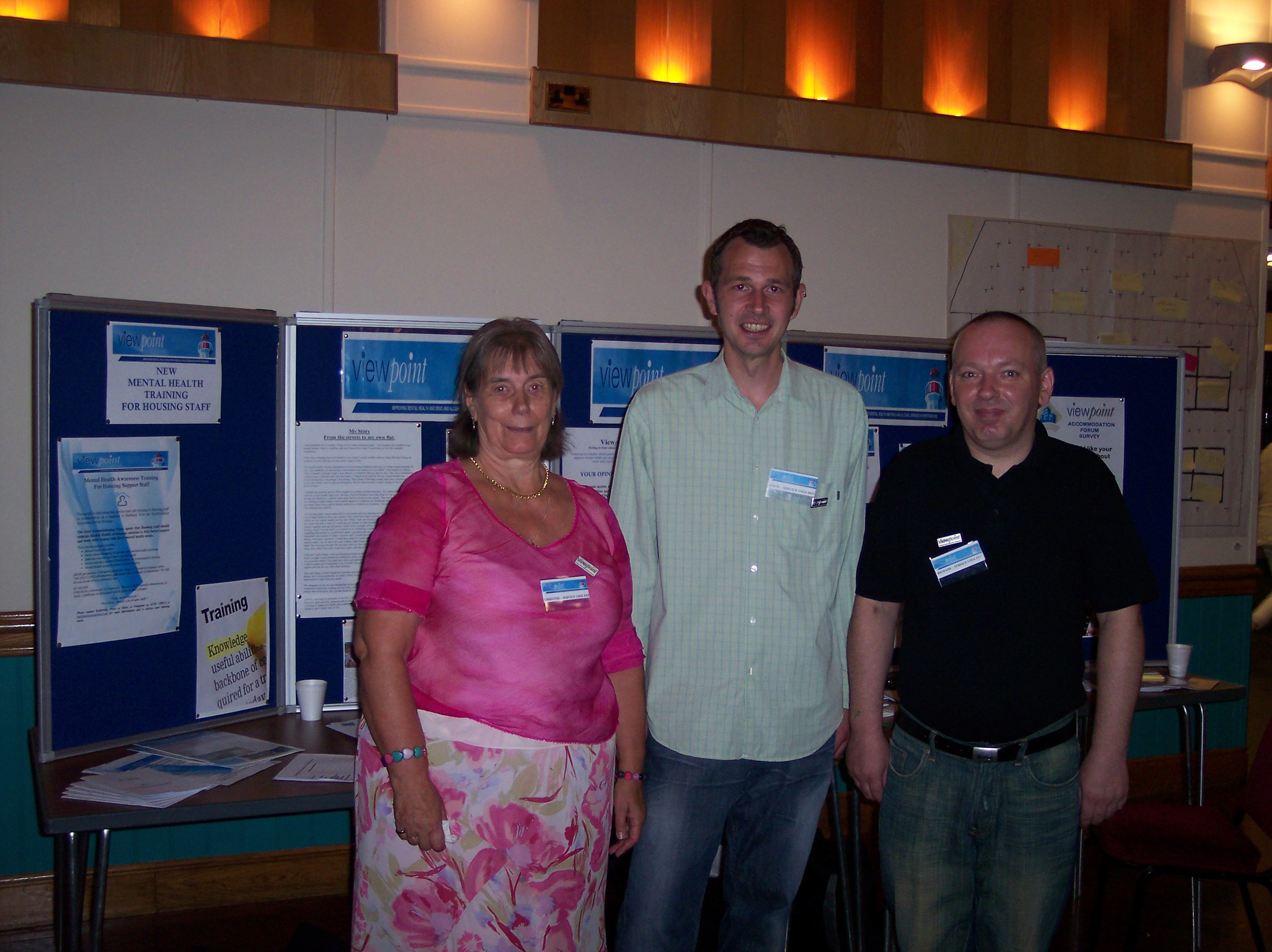 christine, richard and steve reps at viewpoint stand.JPG