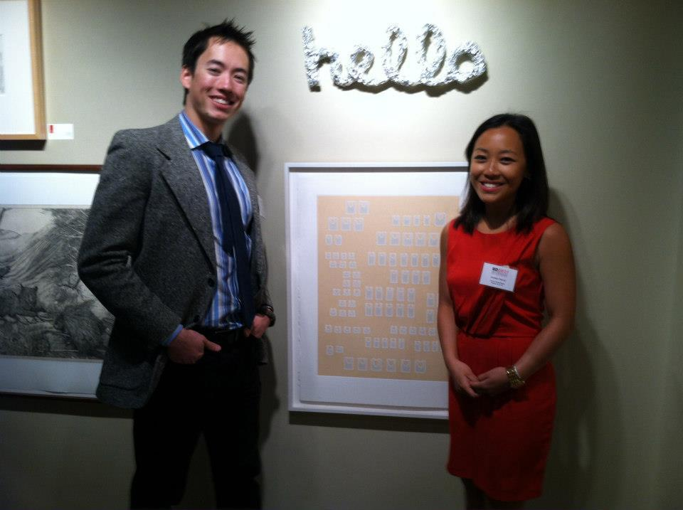 Ryder Stroud and Andrea Cheung in front of works by artist Rachel Perry-Welty at the AD 20/21 fair in March 2013.