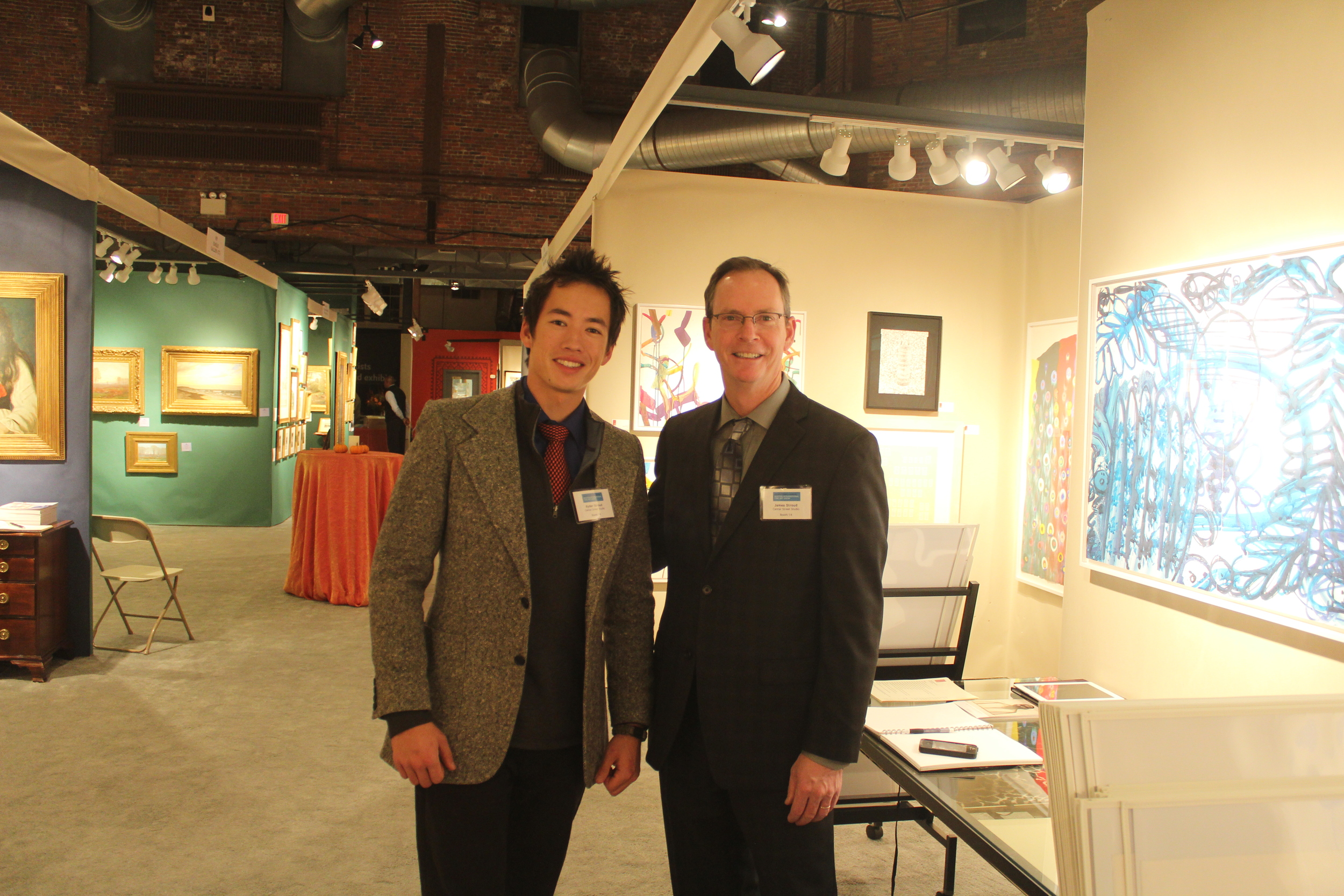 James Stroud and son Ryder Stroud at the Center Street Studio booth during the 2013 Boston International Fine Art Show (BIFAS).