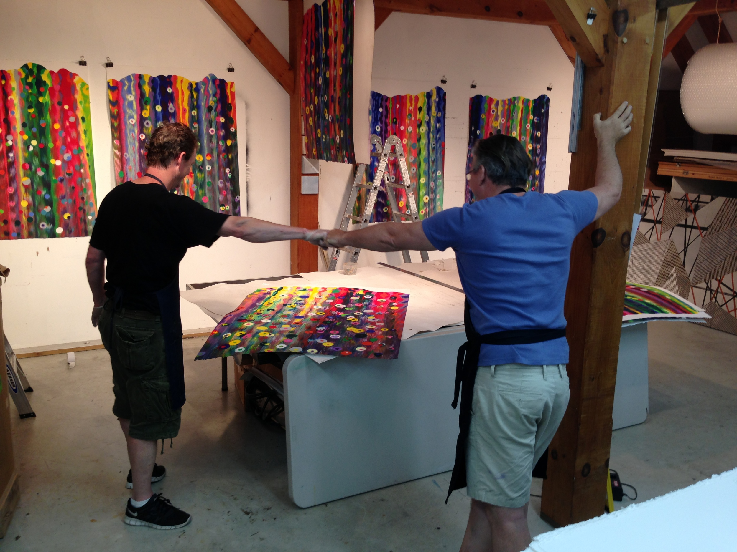 A satisfying fist bump. James Stroud and Markus Linnenbrink celebrate another successful monotype fresh off the press.