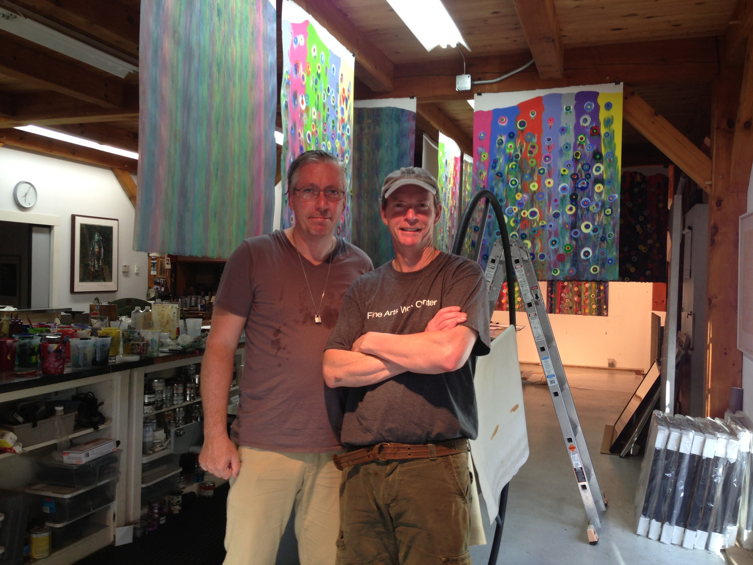 Markus Linnenbrink and James Stroud with a backdrop of Linnenbrink's monotypes IHEARDYOULOOKING. Because the paper is so saturated with ink, they must be hung from the studio rafters for 2 weeks in order to completely dry.
