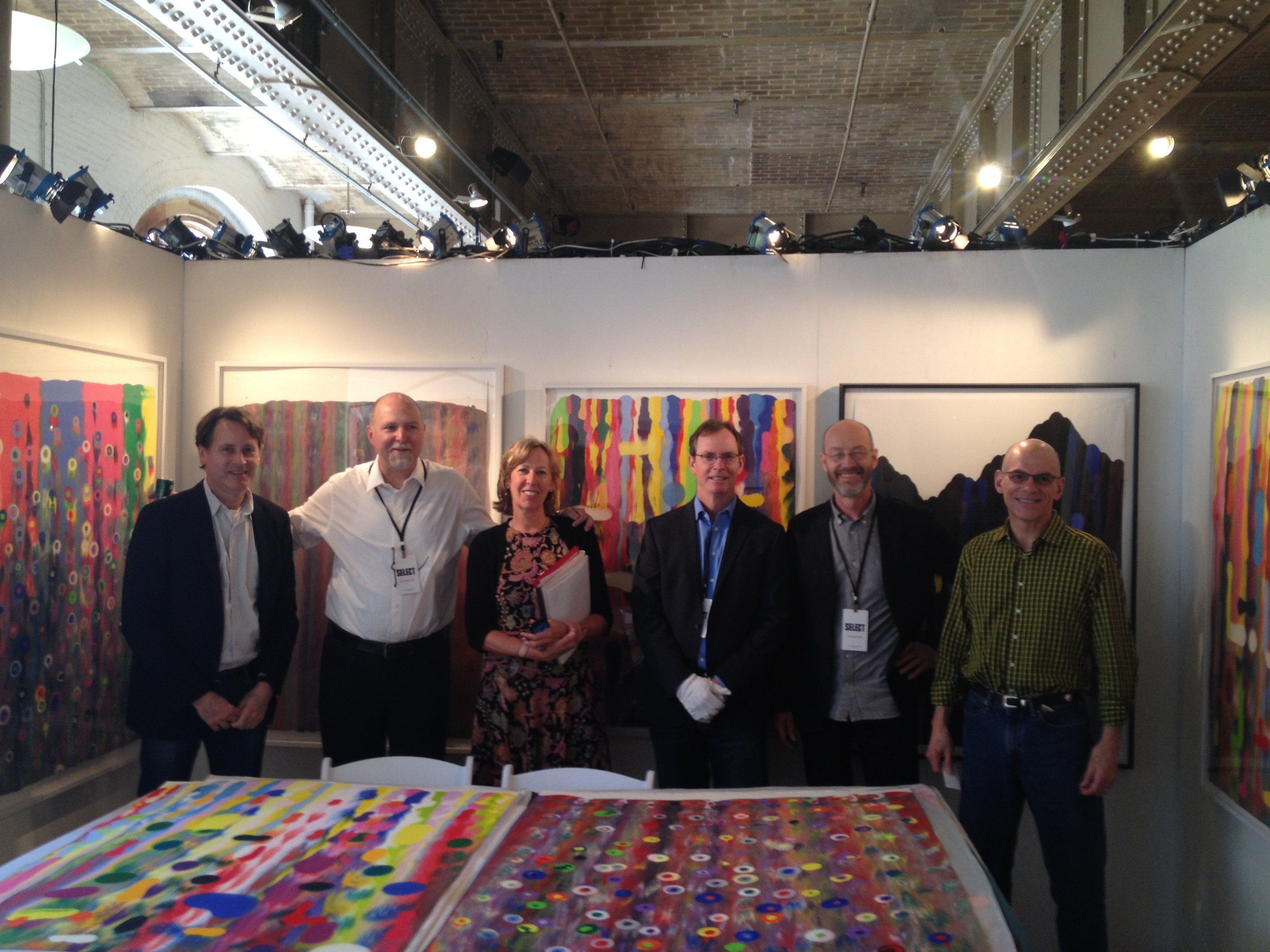 "The ""Justice League of Printmakers"" (from left to right) Andrew Mockler (Jungle Press), Jonathan Higgins (Manneken Editions), Sue Oehme (Oehme Graphics), James Stroud, Peter Pettengill (Wingate Studio), and Cole Rogers (Highpoint Press).  Select Fair 2014"