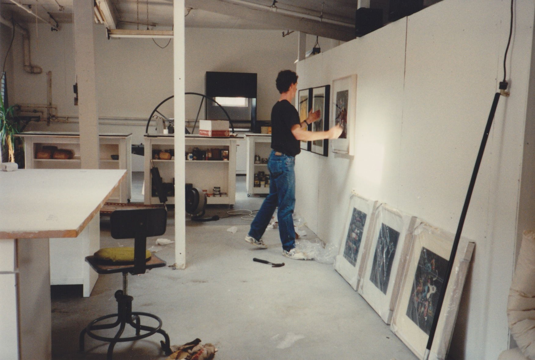 James Stroud hanging James Hansen's work circa 1994.