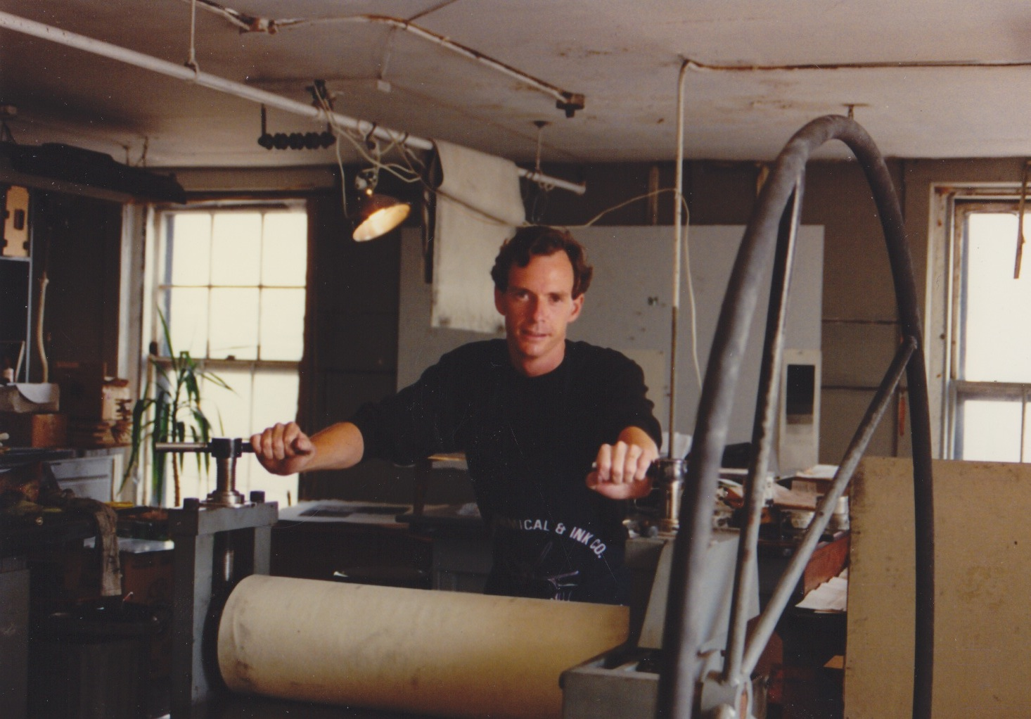 James Stroud with CSS's first press, a French-American tool press at Boston's Distillery Building in the early 1990s.