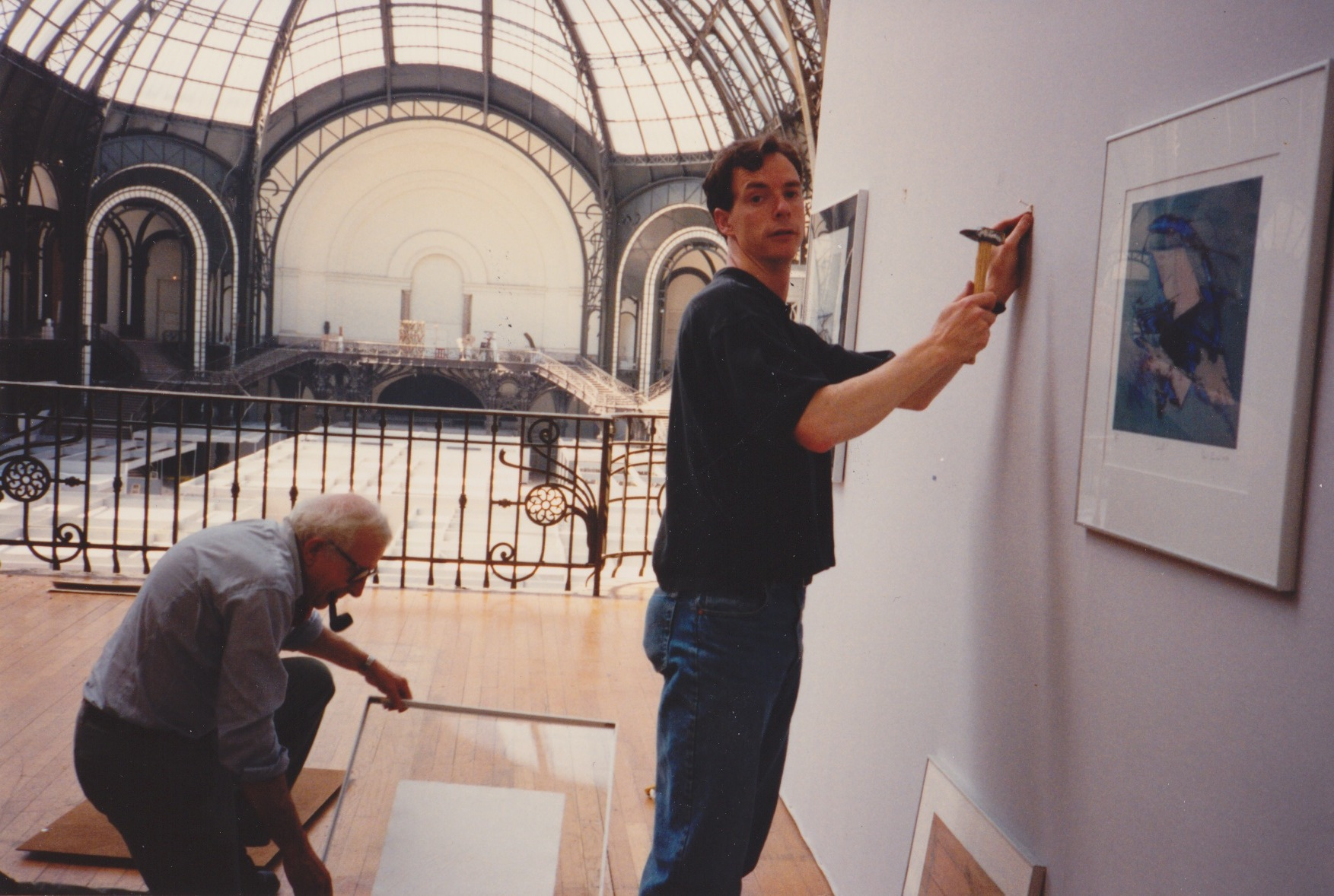 George Ball and James Stroud hanging work in preparation for Salon de Mai circa 1987.