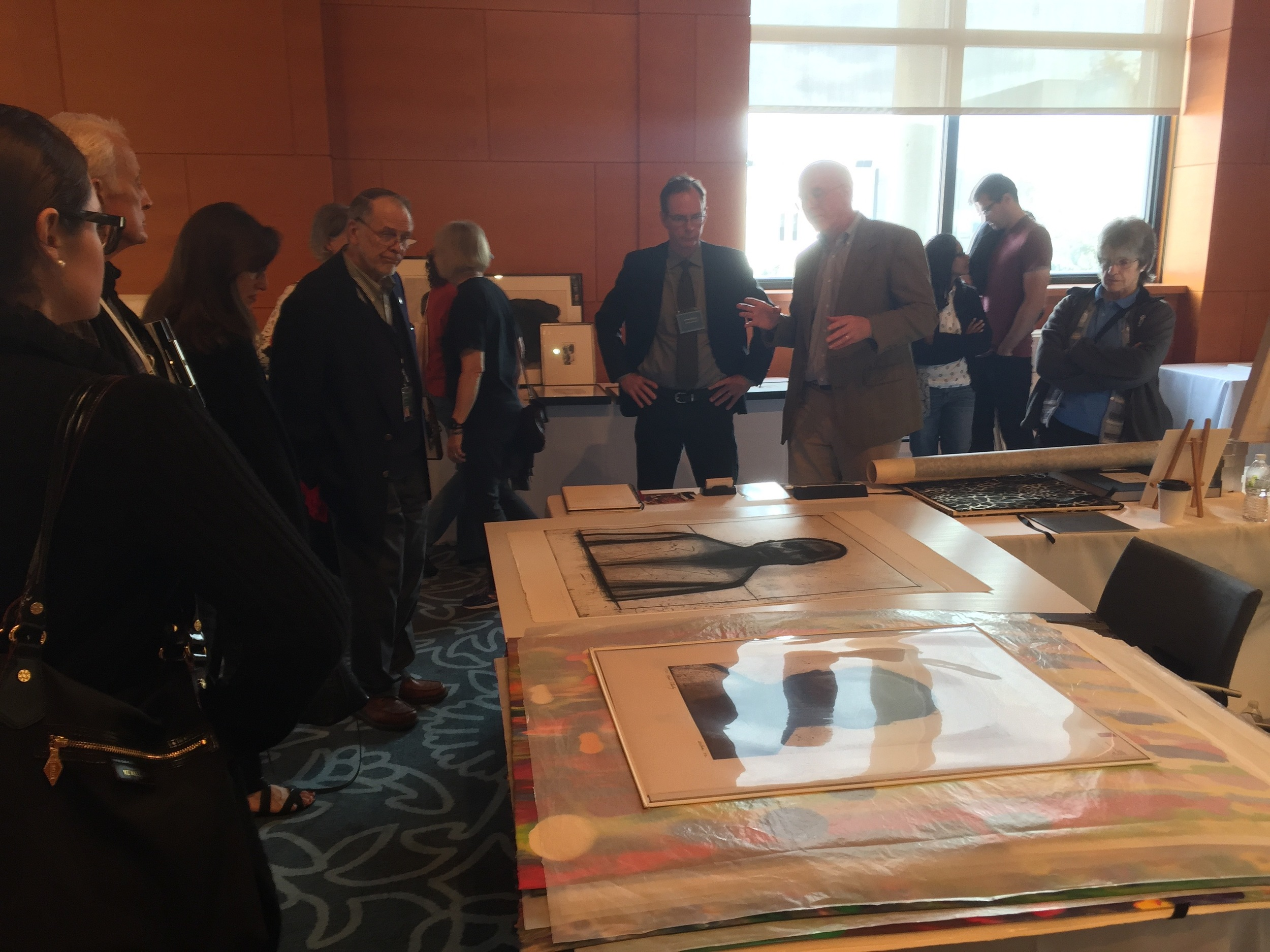 James Stroud and Tom Rassieur give a presentation on John Wilson's  Martin Luther King, Jr.  etching at the CSS booth during the Minneapolis Institute of Art's Prints and Drawings Fair in October 2015.