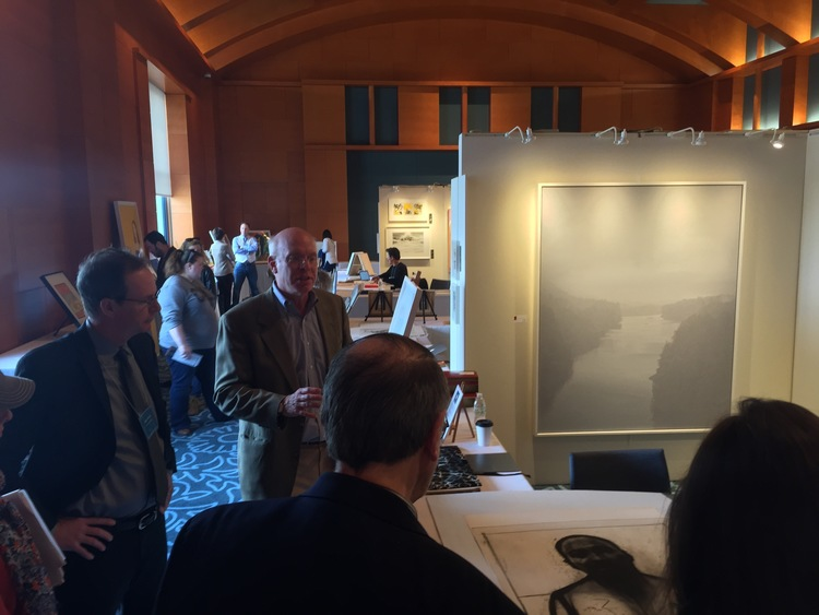 """James Stroud and Minneapolis Institute of the Arts prints and drawings curator Tom Rassieur giving a brief lecture during the show to Rassieur's print class on John Wilson's """"Marting Luther King, Jr."""" etching."""