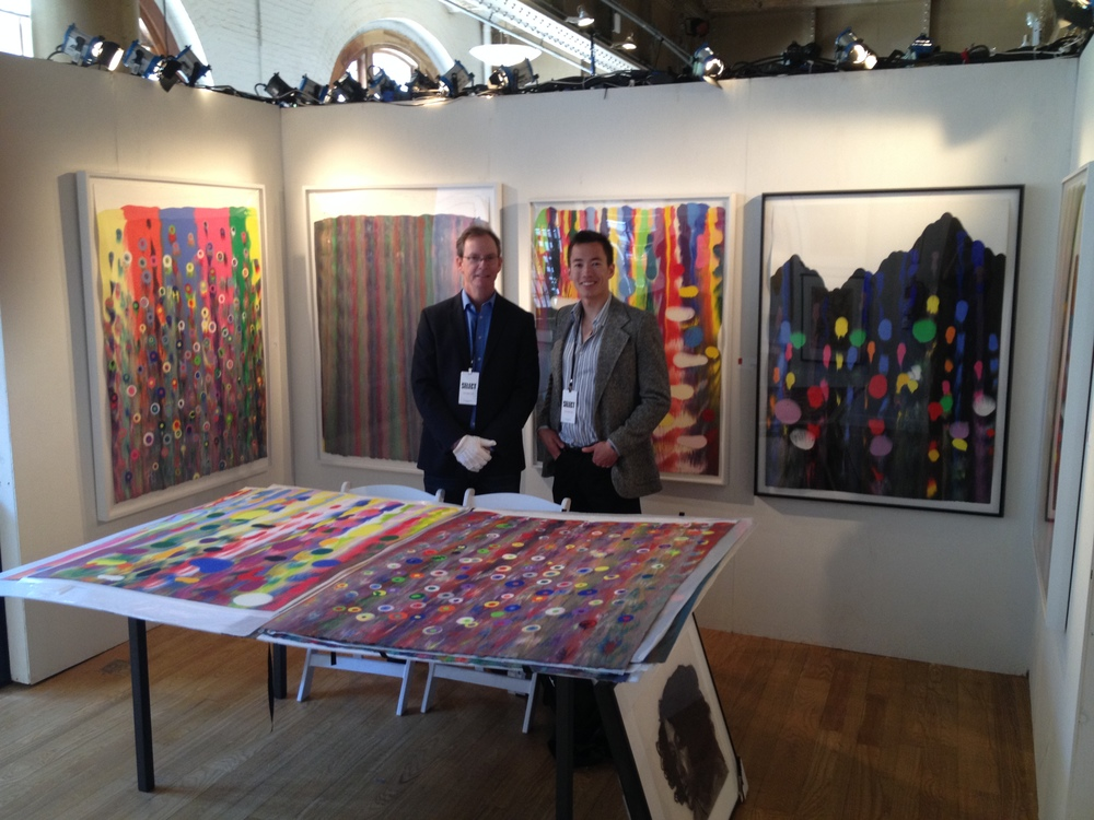 James Stroud and Ryder Stroud manning the booth featuring artist Markus Linnenbrink's work