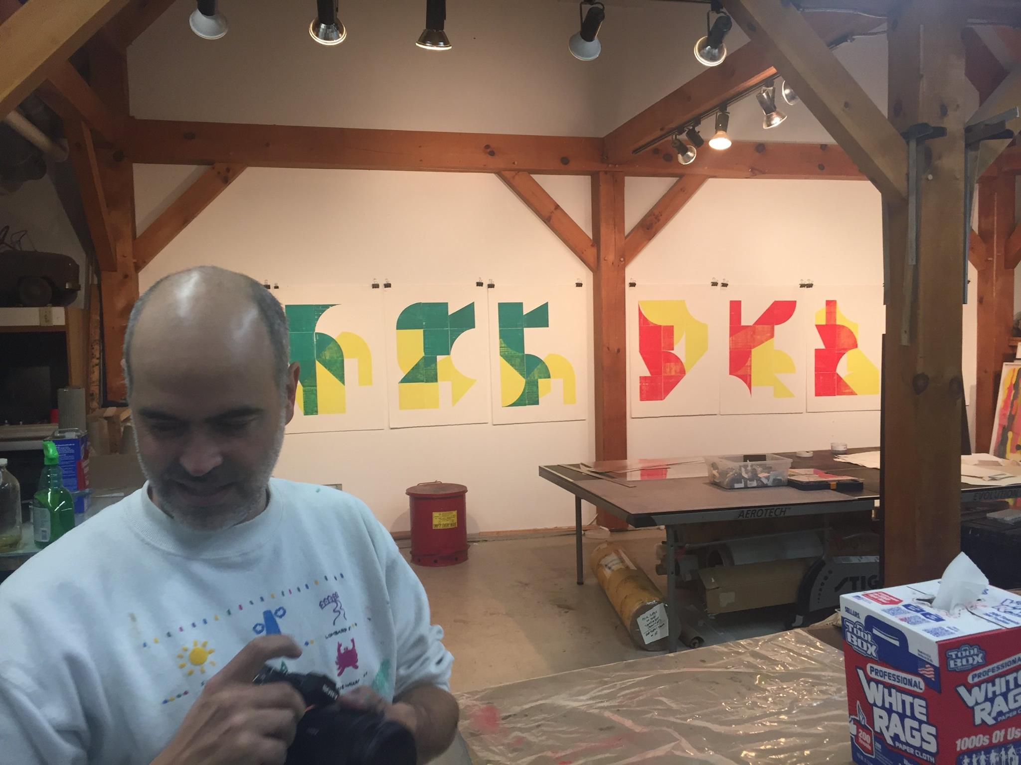 All in a day's work: the prints, hot-off-the-press, hang on the walls of the shop to dry.