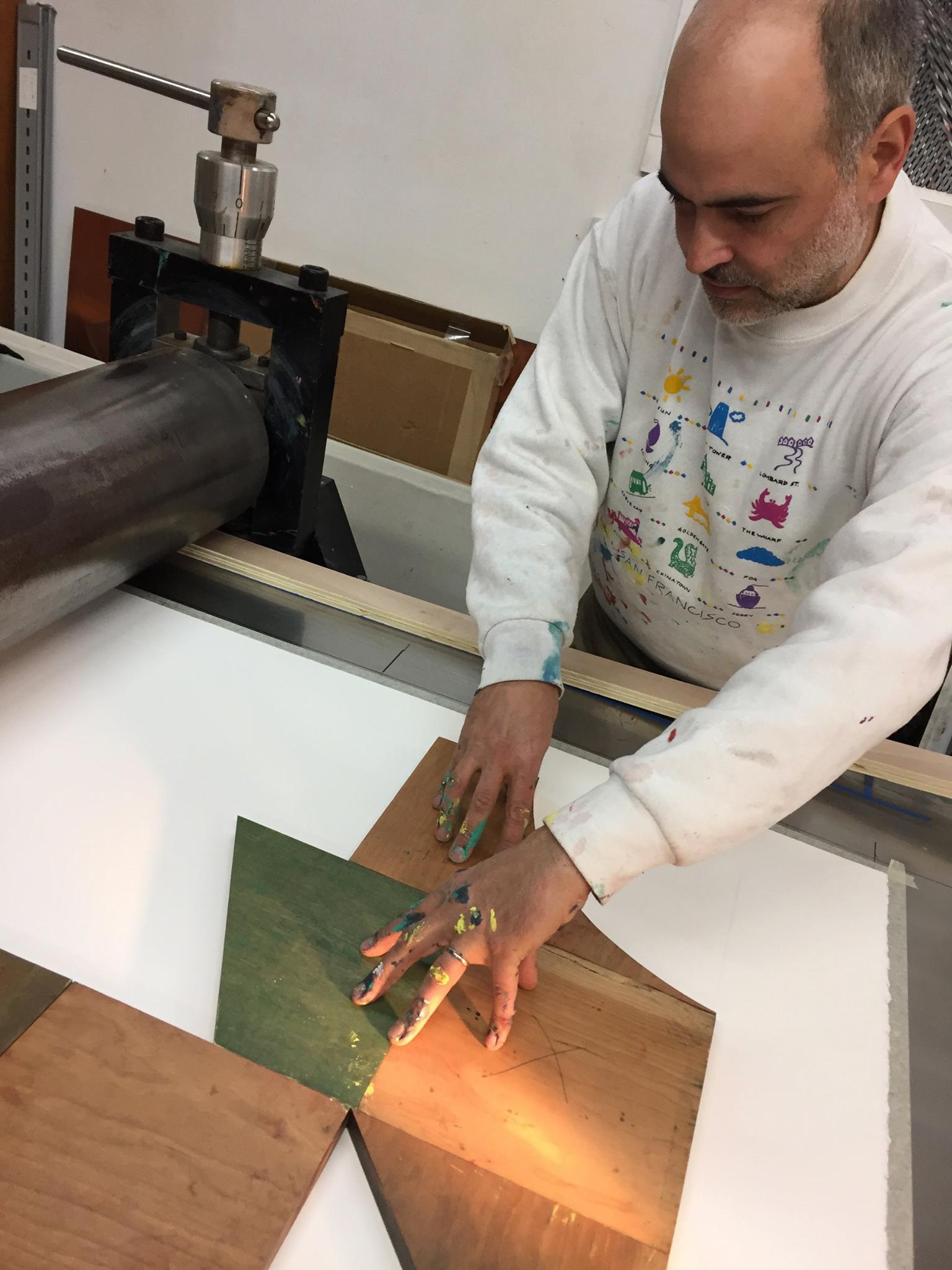Eltono lays out the woodblocks on the press bed.