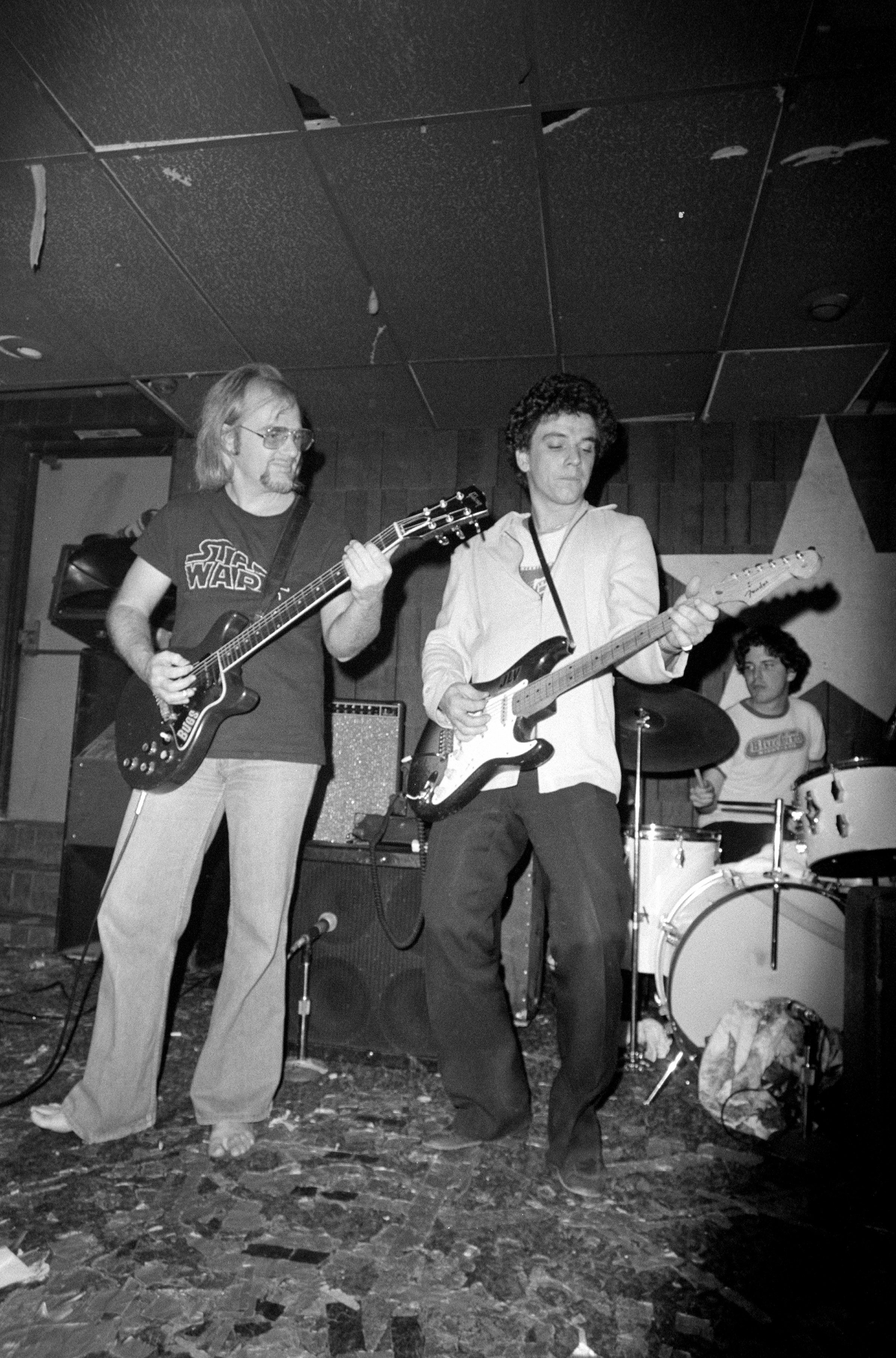 Bugs Henderson and Jimmie Vaughan, at Sneaky Pete's in Medallion Center, Dallas, TX, in 1977. That's Mike Buck on the drums.