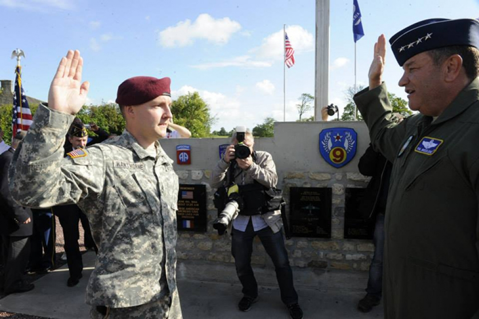 U.S. Army Sgt. First Class Brian A. Hawthorne, B.A. '10, M.A. '12, reenlisted in the Army Reserve in Picauville, France in June, before attending D-Day events. (U.S. Army Photo By Spc. Joshua E. Powell)