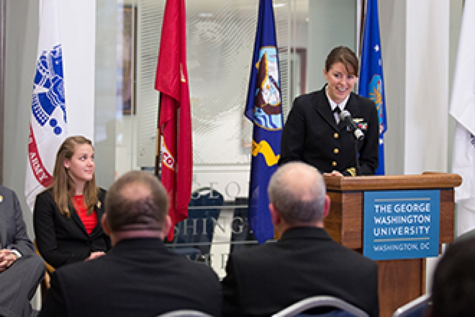 Lt. Comm. Alex Greene addresses the university community during the Veterans Day celebration at the Marvin Center on Monday.