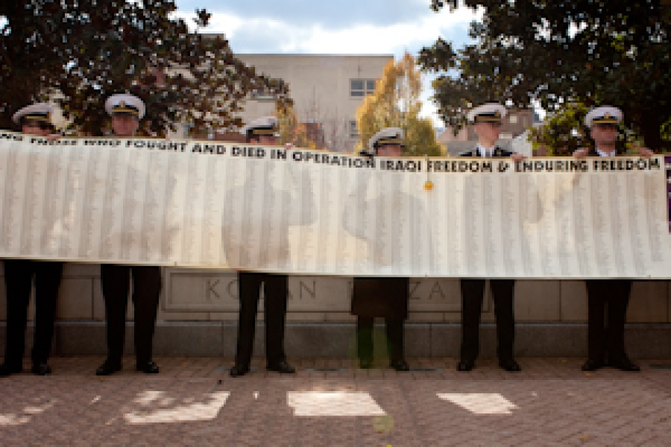 GW veterans hold a banner featuring the names of the more than 2,000 soldiers who died during Operation Iraqi Freedom. The banner was given to the GW Vets student organization at George Washington's Veterans Day Ceremony on Friday.