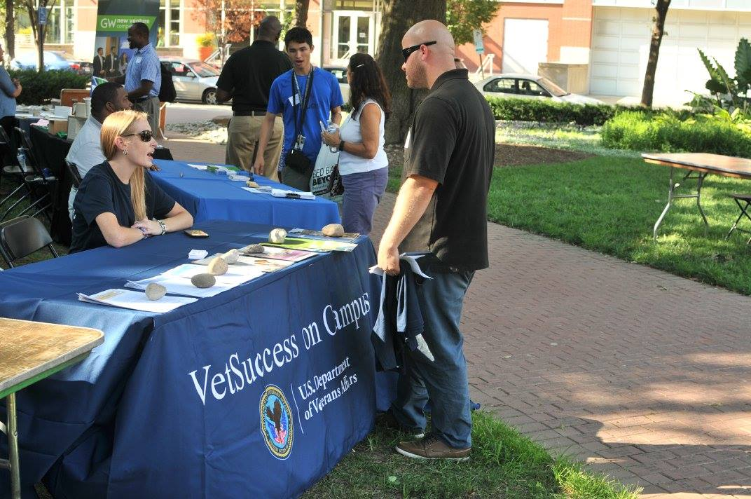 Vetsuccess-on-Campus counselor Laura Ferraro speaking with students at the GW VALOR Tailgate