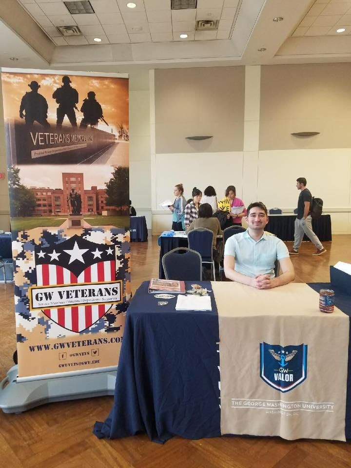 Fundraising Director Charlie Spirtos hosts a table at the incoming student services fair to discuss GW Veterans.