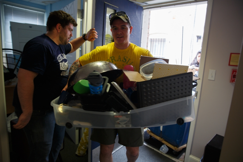 Volunteers Alex Morris (l), B.S. '17, and Max Alexander, a graduate student in the School of Engineering, bring donated household goods to the Military Community Center on the Foggy Bottom Campus. (William Atkins/GW Today)