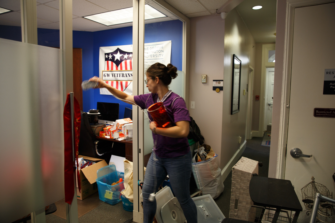 Verónica María Hoyer, B.A. '17, organizes donated items in the Military Community Center at 2035 F St N.W. Ms. Hoyer is an Air Force veteran who served in Afghanistan. As an undergraduate student, she was involved with GW Veterans and the Afghan Student Association.  (William Atkins/ GW Today)