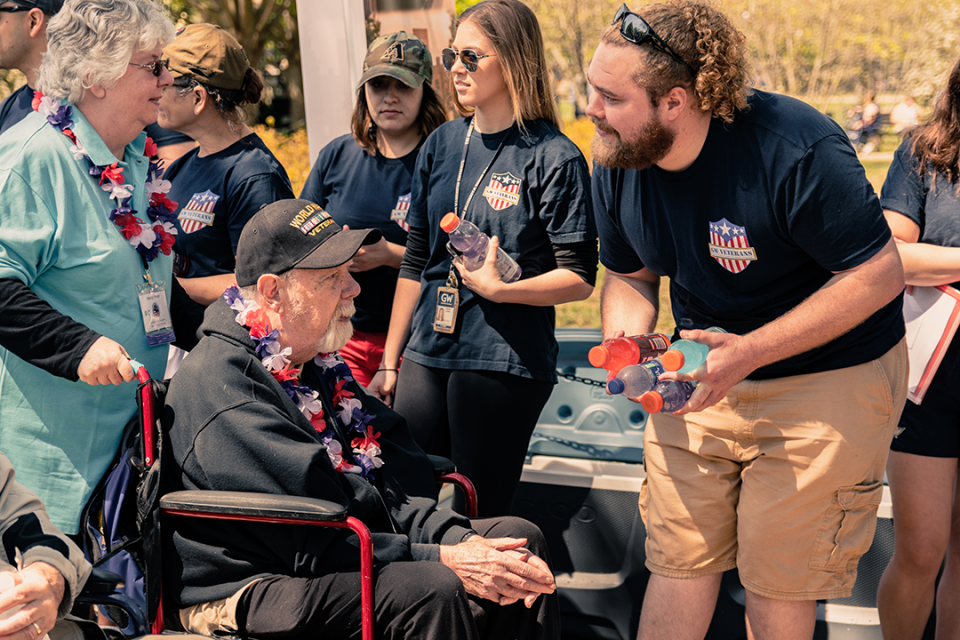 GW Veterans greet Honor Flight veterans at the World War II Memorial during the Military Mile Memorial March (M4) in April. (Photo: Zack Brodie)