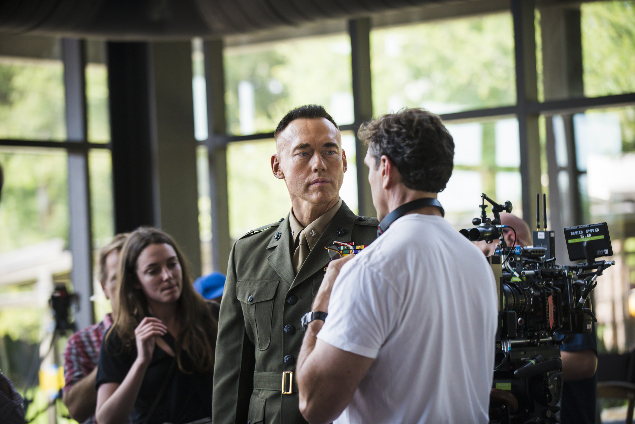 """Actor, Kevin Durand and Director Tim Williams discuss a scene from the filming of """"The Colonel""""."""